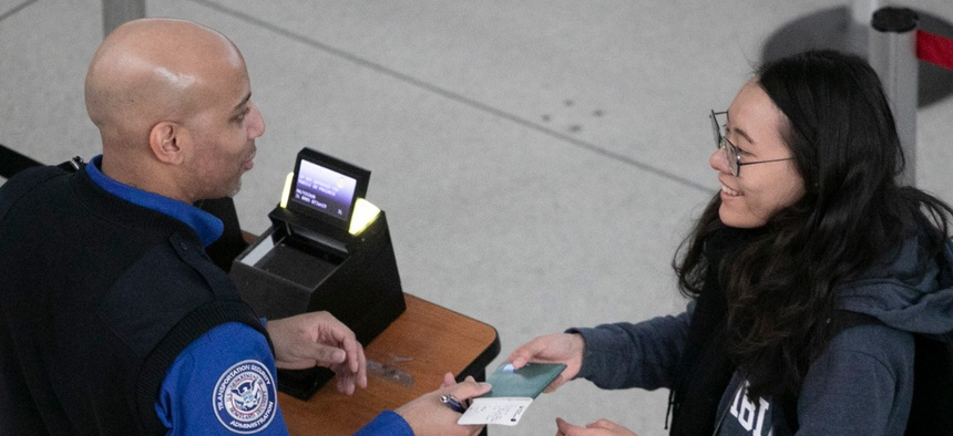 Airline passenger passing through TSA with a Real ID