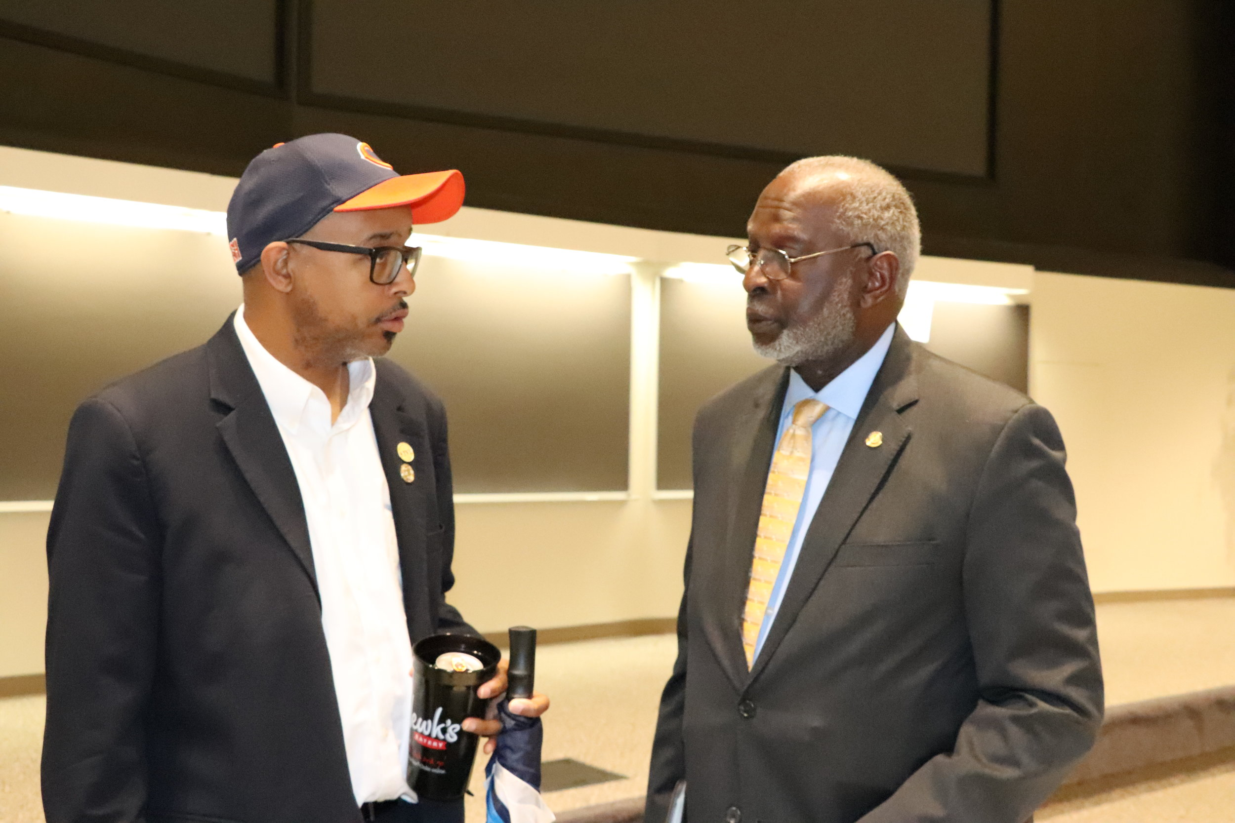 Dr. Satcher chats with a local pastor after the lecture