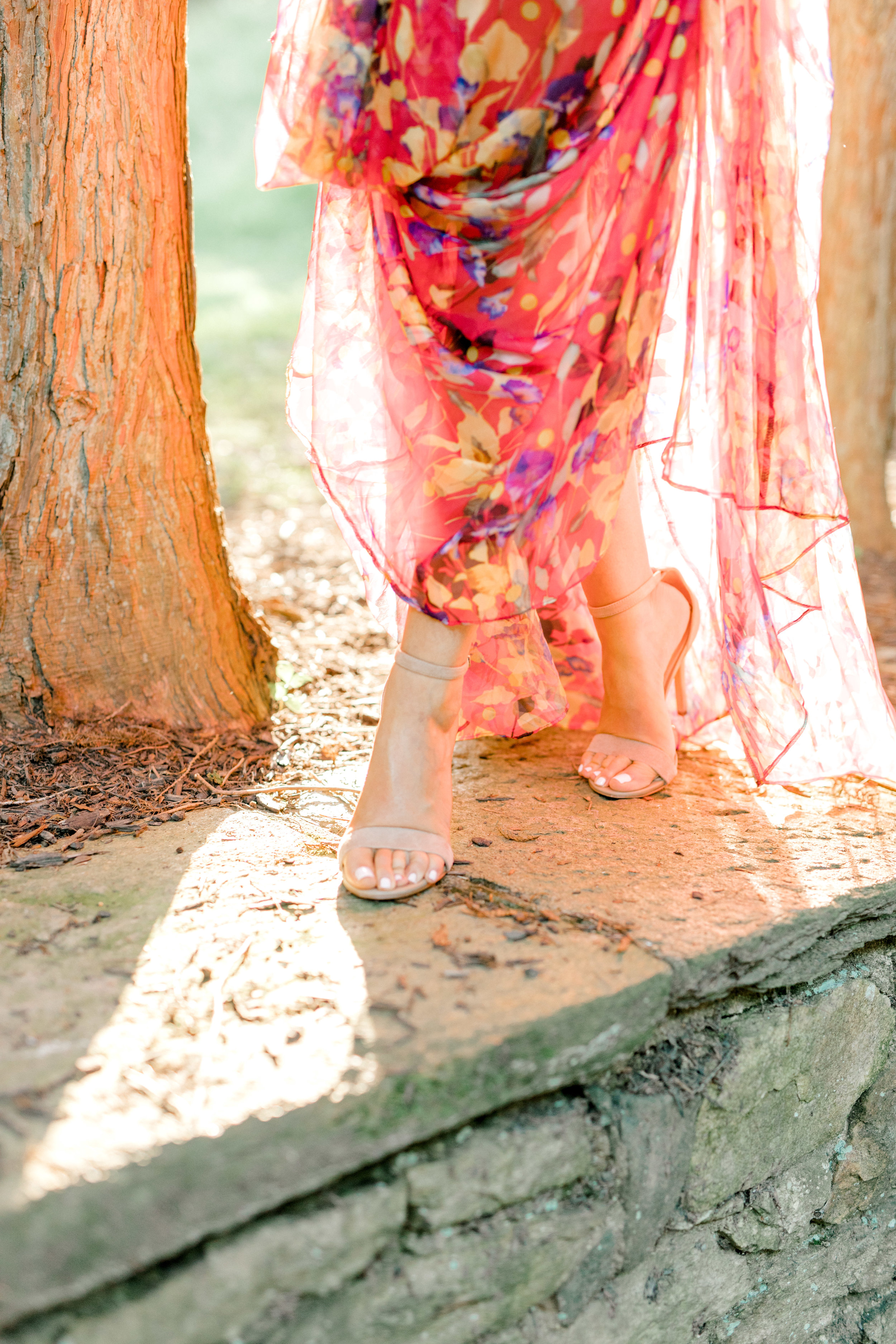 We absolutely adore the way the sun shines through this sheer red dress paired with stylish nude heels for Liz and Bill's romantic sunset woodland engagement session at Parque at Ridley Creek