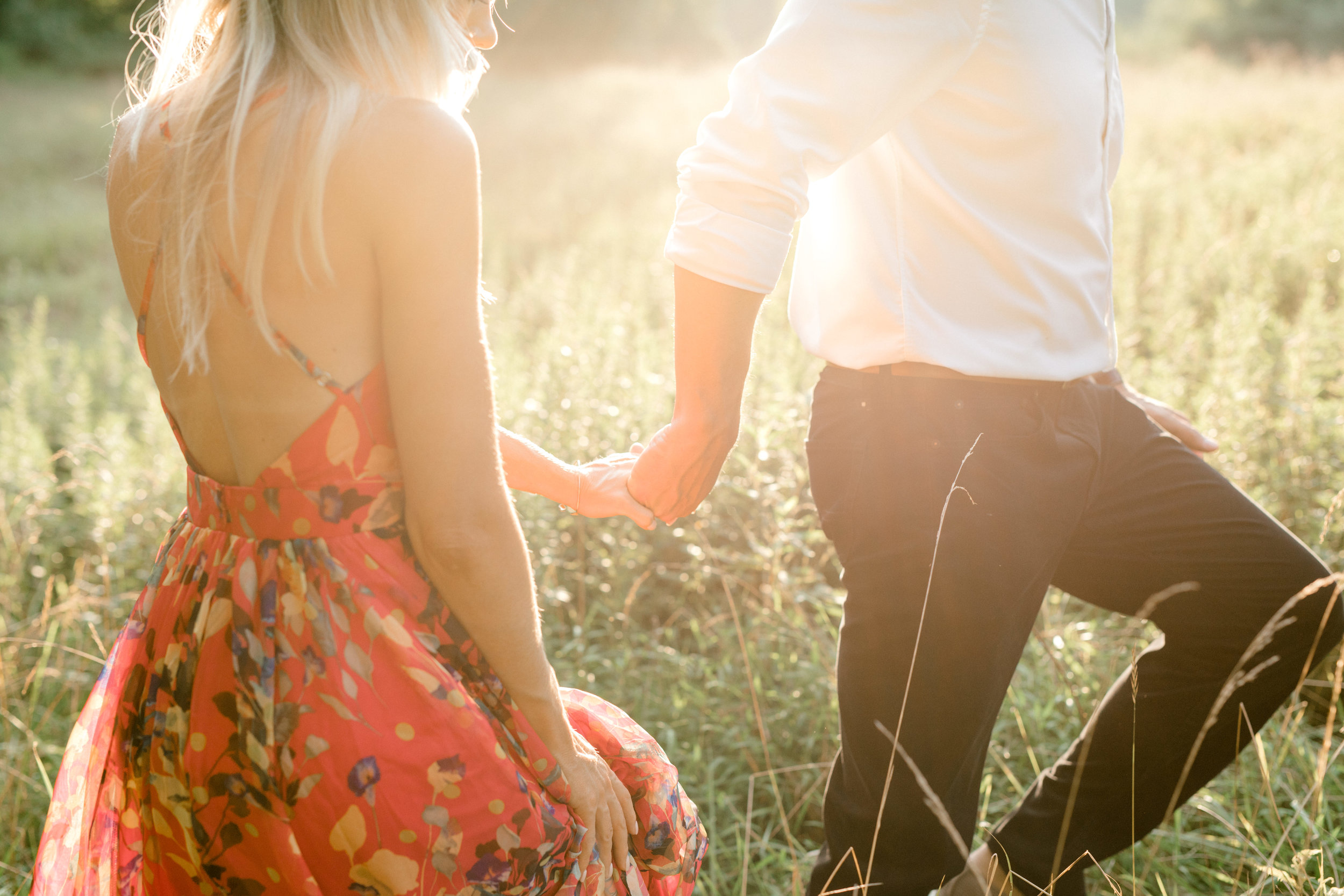 In this romantic sunset woodland engagement session at Parque at Ridley Creek, Bill leads Liz into a glowing sunlit field hand-in-hand. An intimate moment that feels a little boho, we love it.