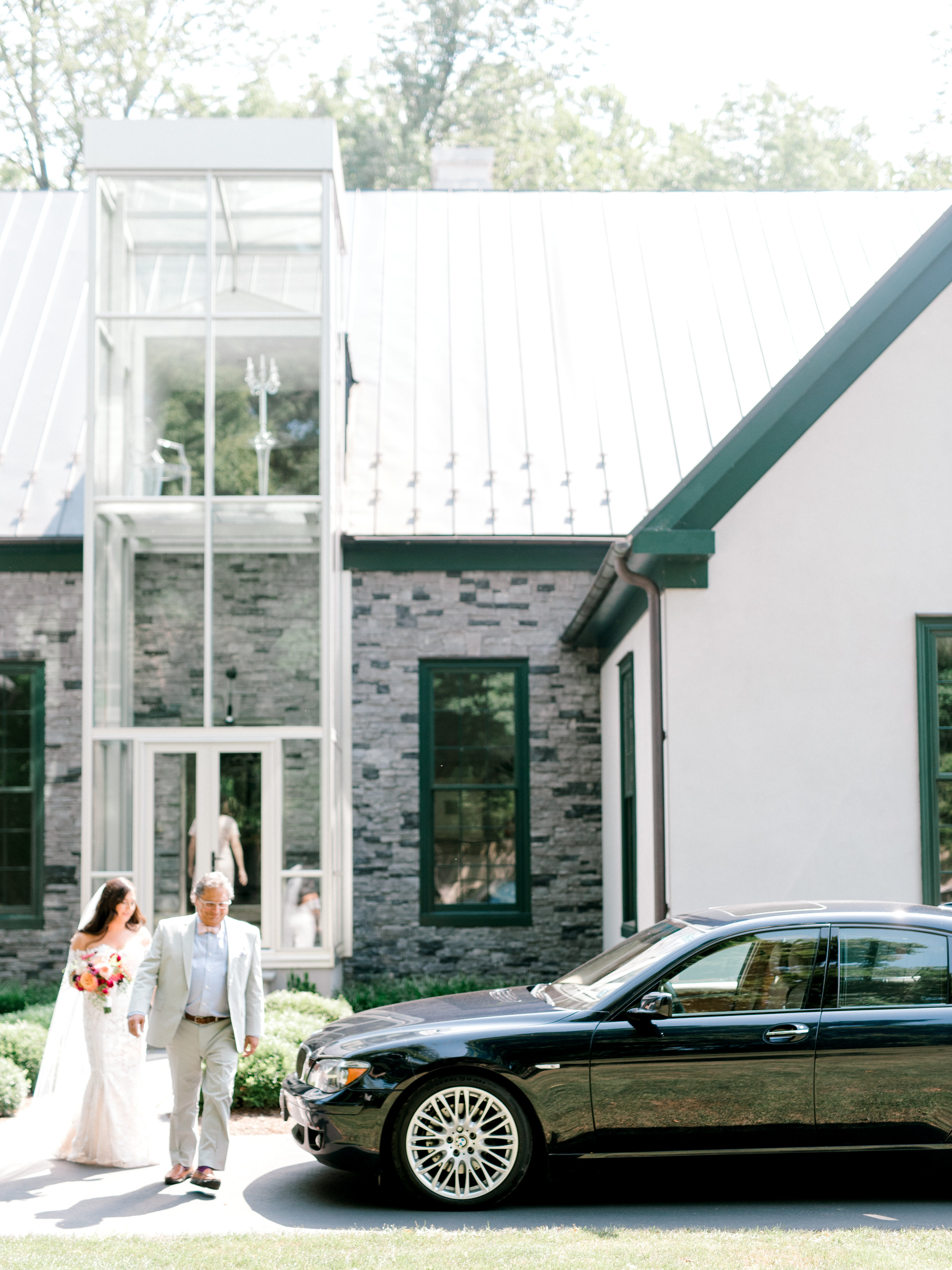 Lindsey and her dad head out to Hotel du Village for Lindsey's colorful and modern summer wedding day.