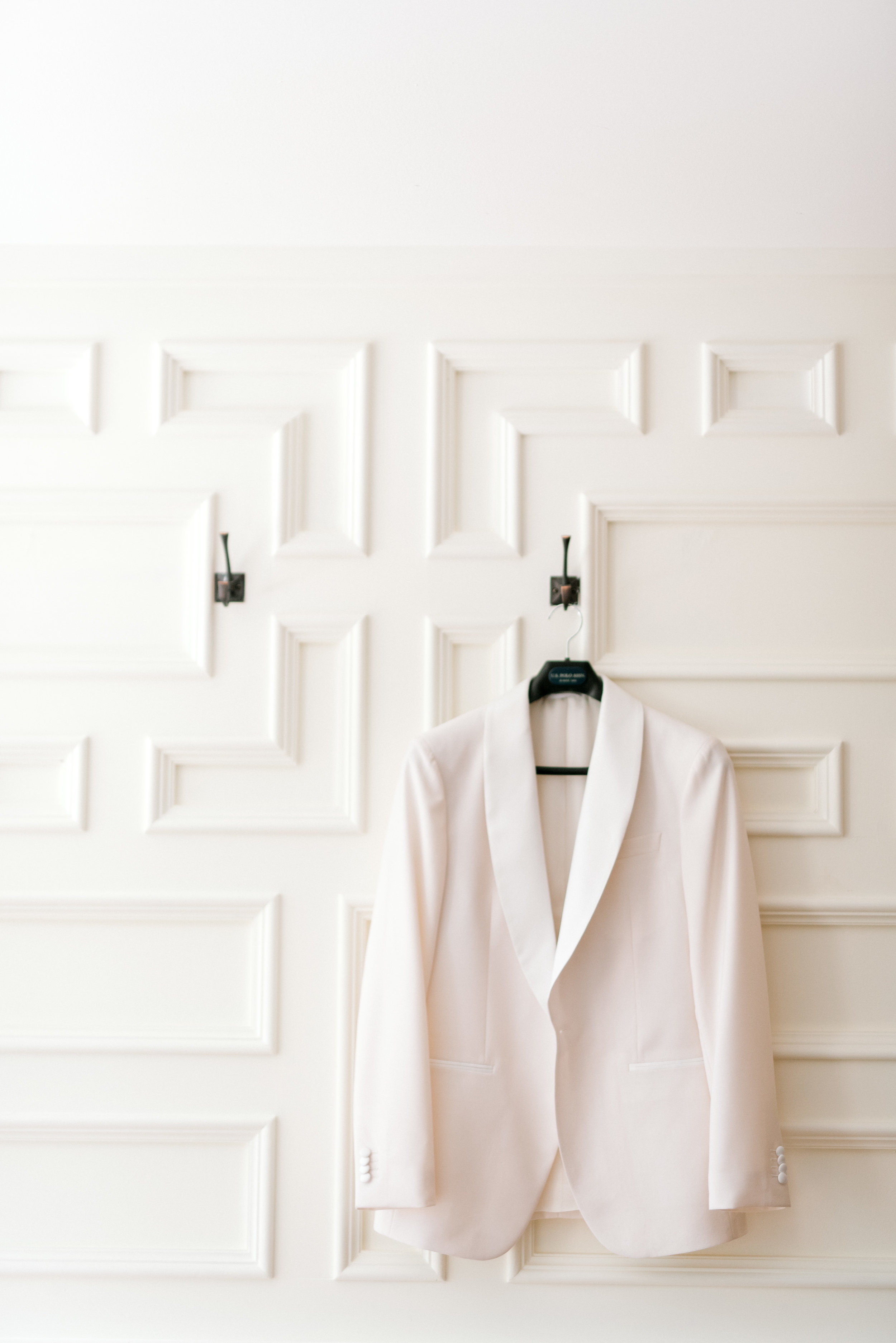 We love a white suite for a bright modern summer wedding like this one that James wore for his day at Hotel du Village.