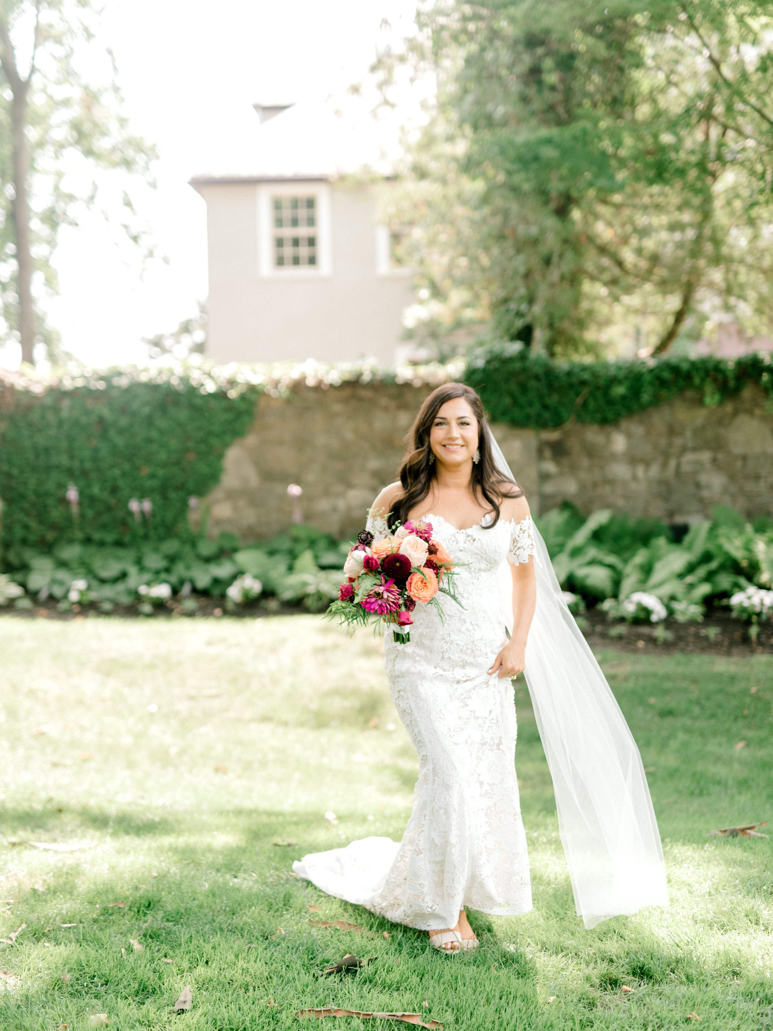 Lindsey carried a bright and colorful bouquet from The Pod Shop that paired so well with her classic Lover's Society lace gown for her modern sunny summer wedding at Hotel du Village.