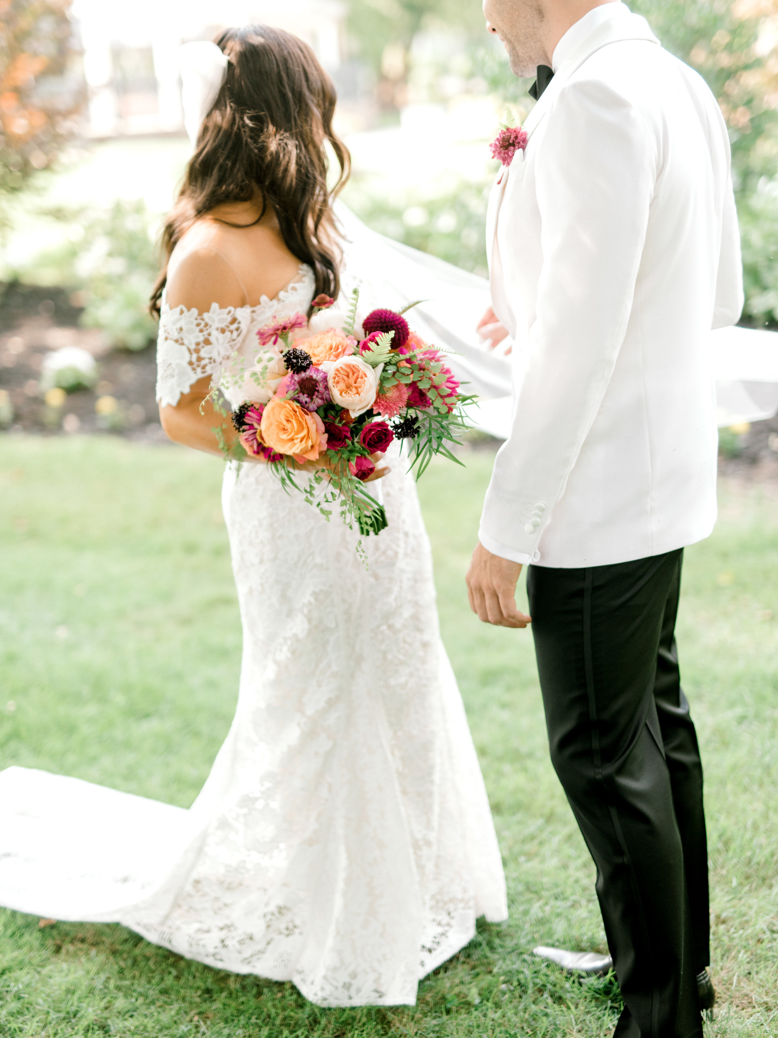 We absolutely adore this modern colorful flowers paired with the classic black and white look for this modern summer wedding at Hotel du Village.