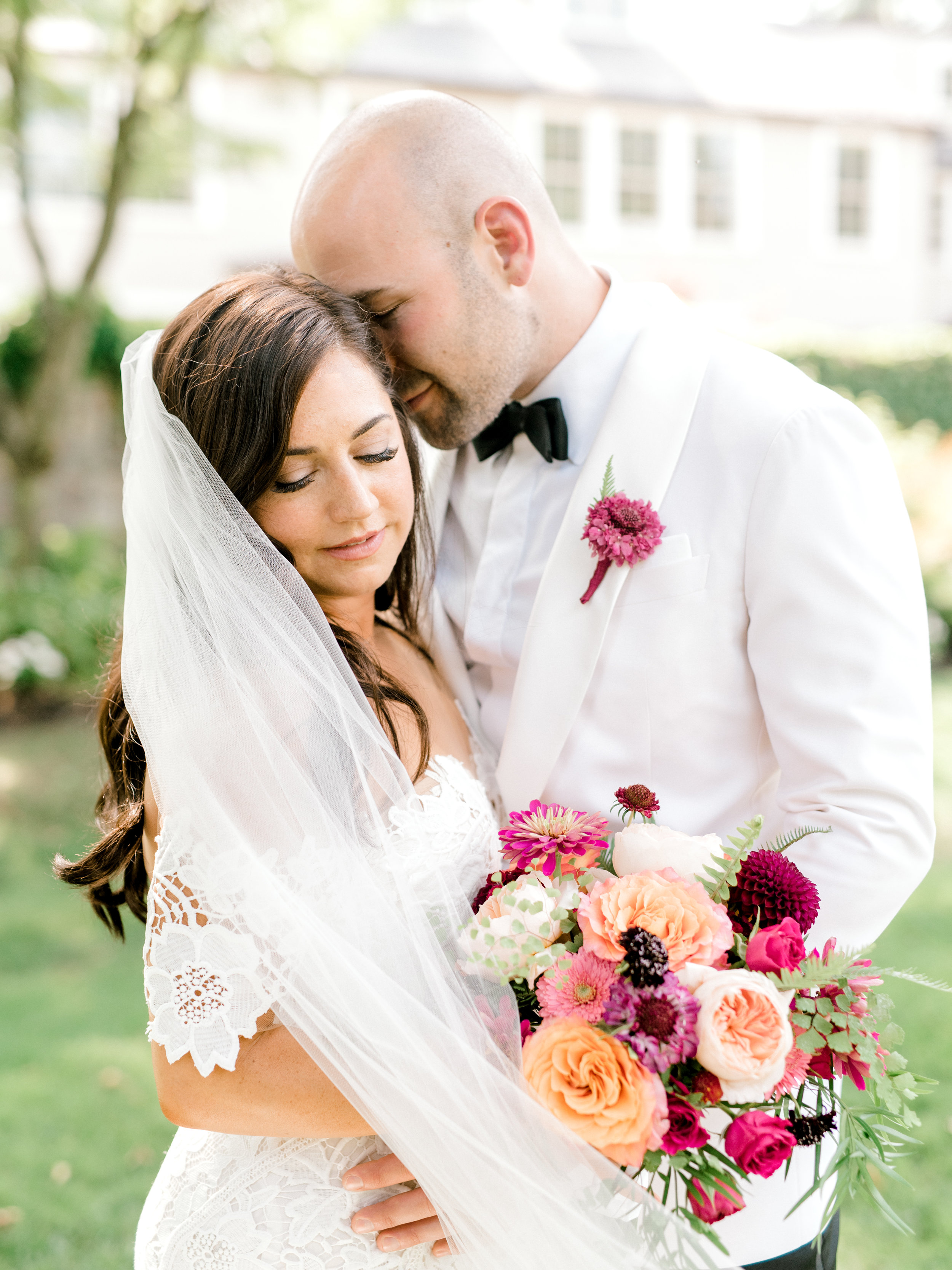 Lindsey and James share an intimate moment before the ceremony for their colorful and modern summer wedding day at Hotel du Village.