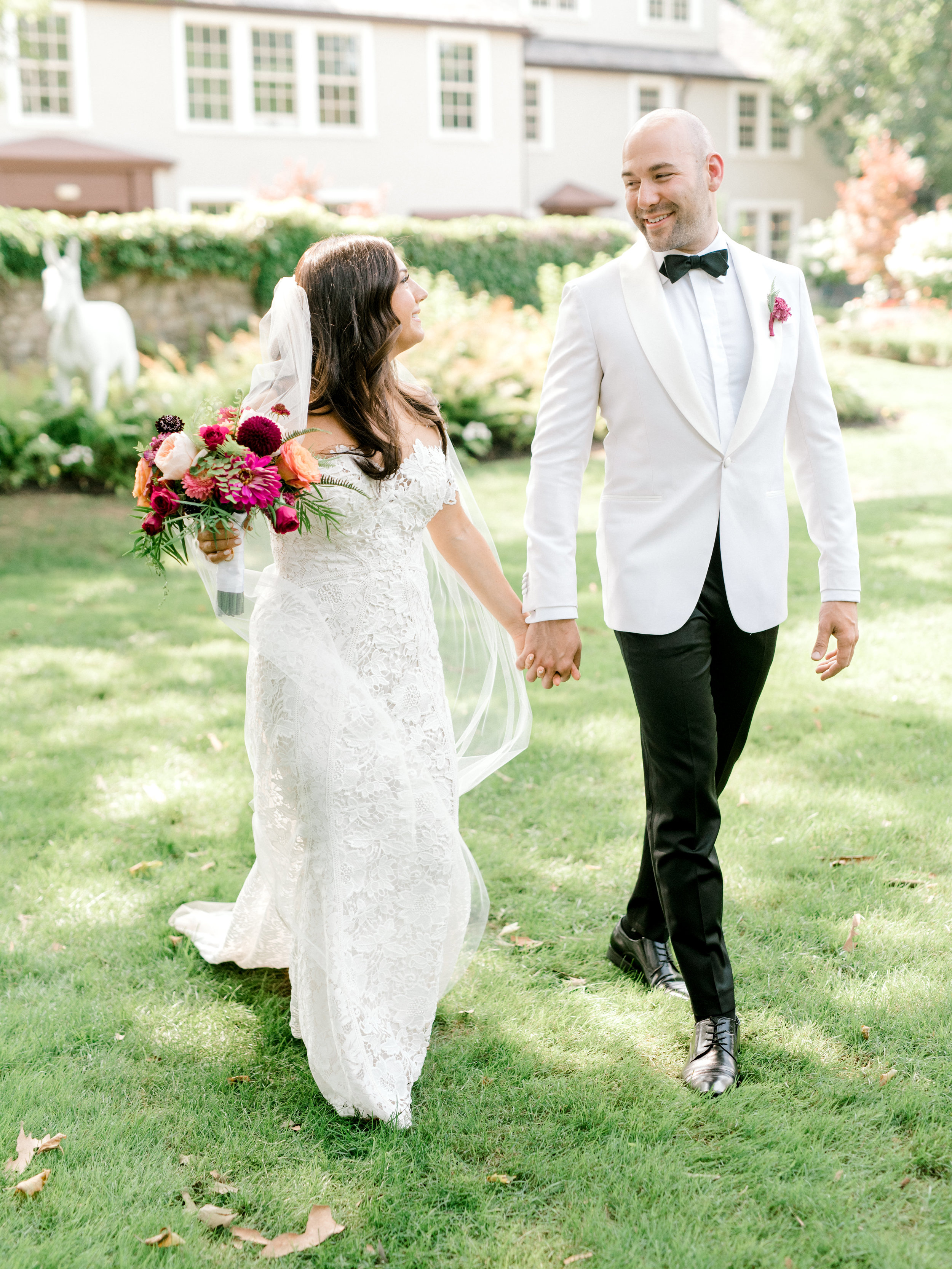 We loved the bright and modern look of whites mixed with bold pops of color for Lindsey and James's summer wedding at Hotel du Village.