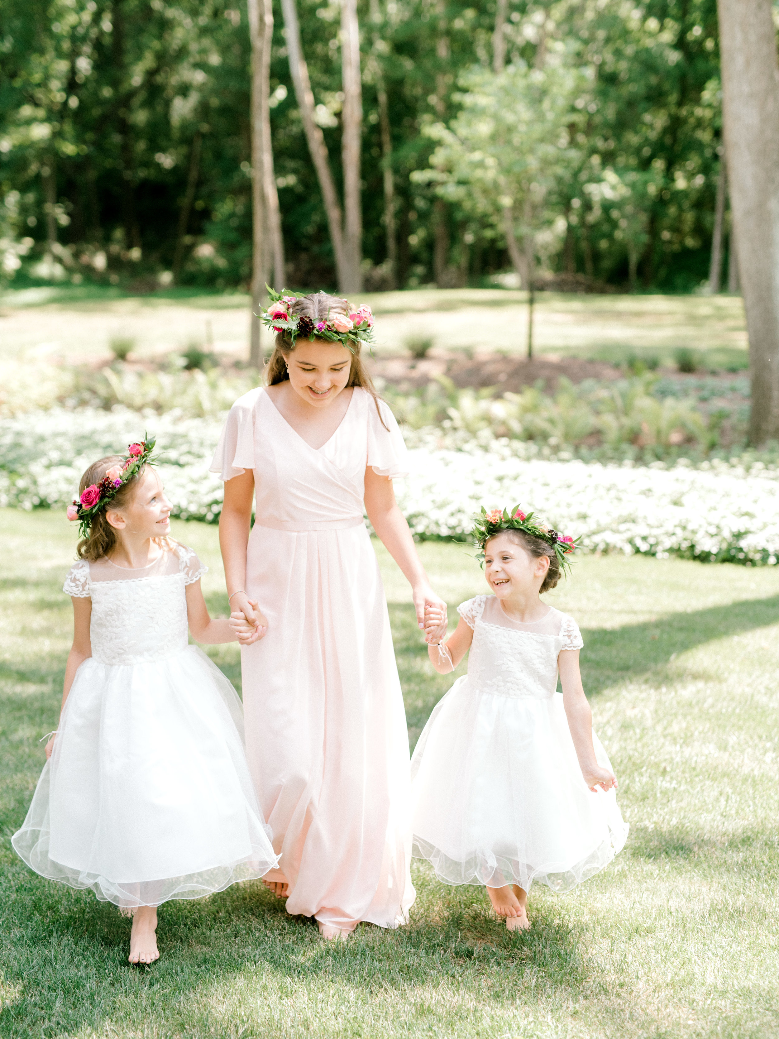 The prettiest little flower girls in pink and white for Lindsey and James's bright and modern summer wedding at Hotel du Village.