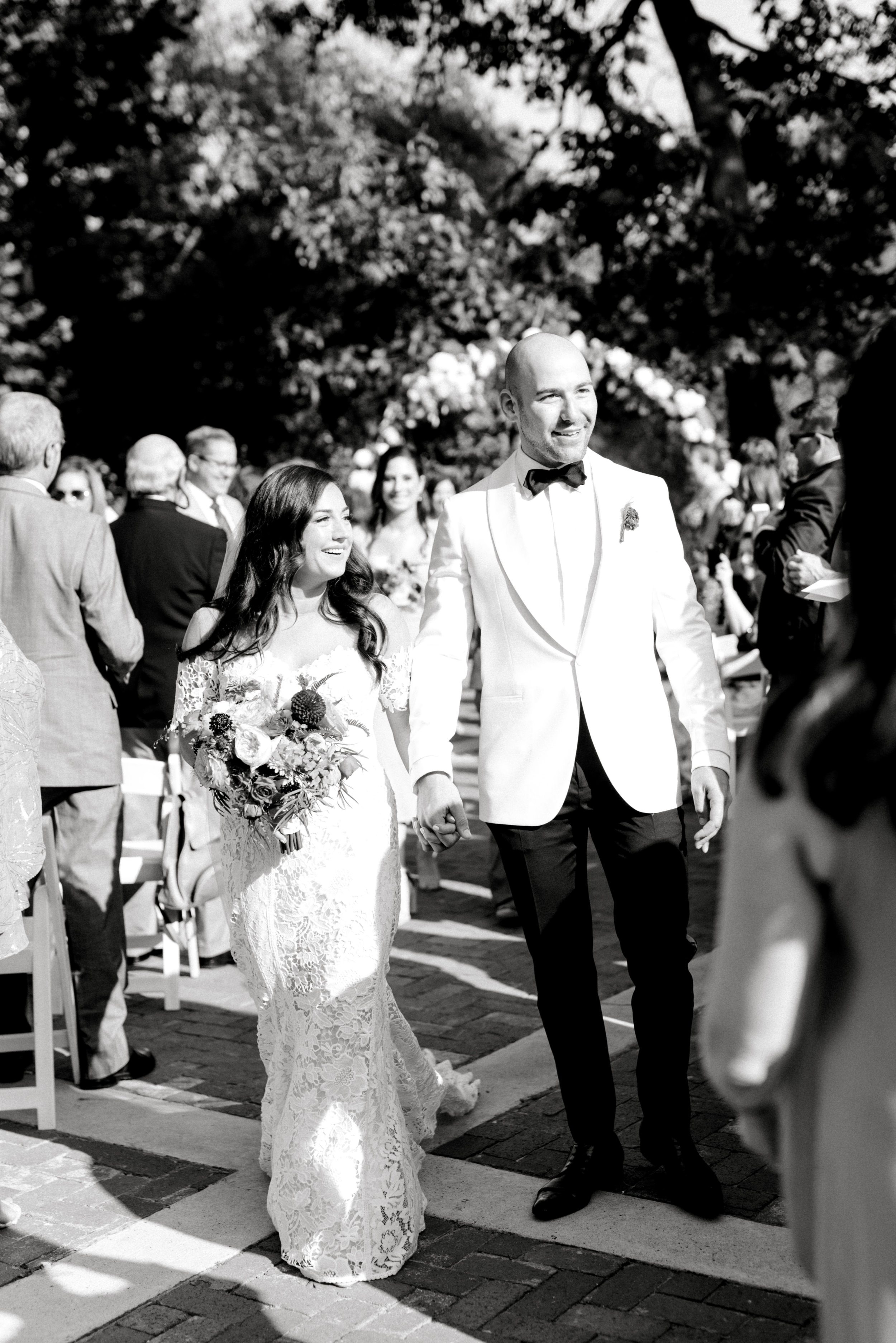 Happily married, these two recess back down the aisle after saying their vows for their bright summer wedding at Hotel du Village.