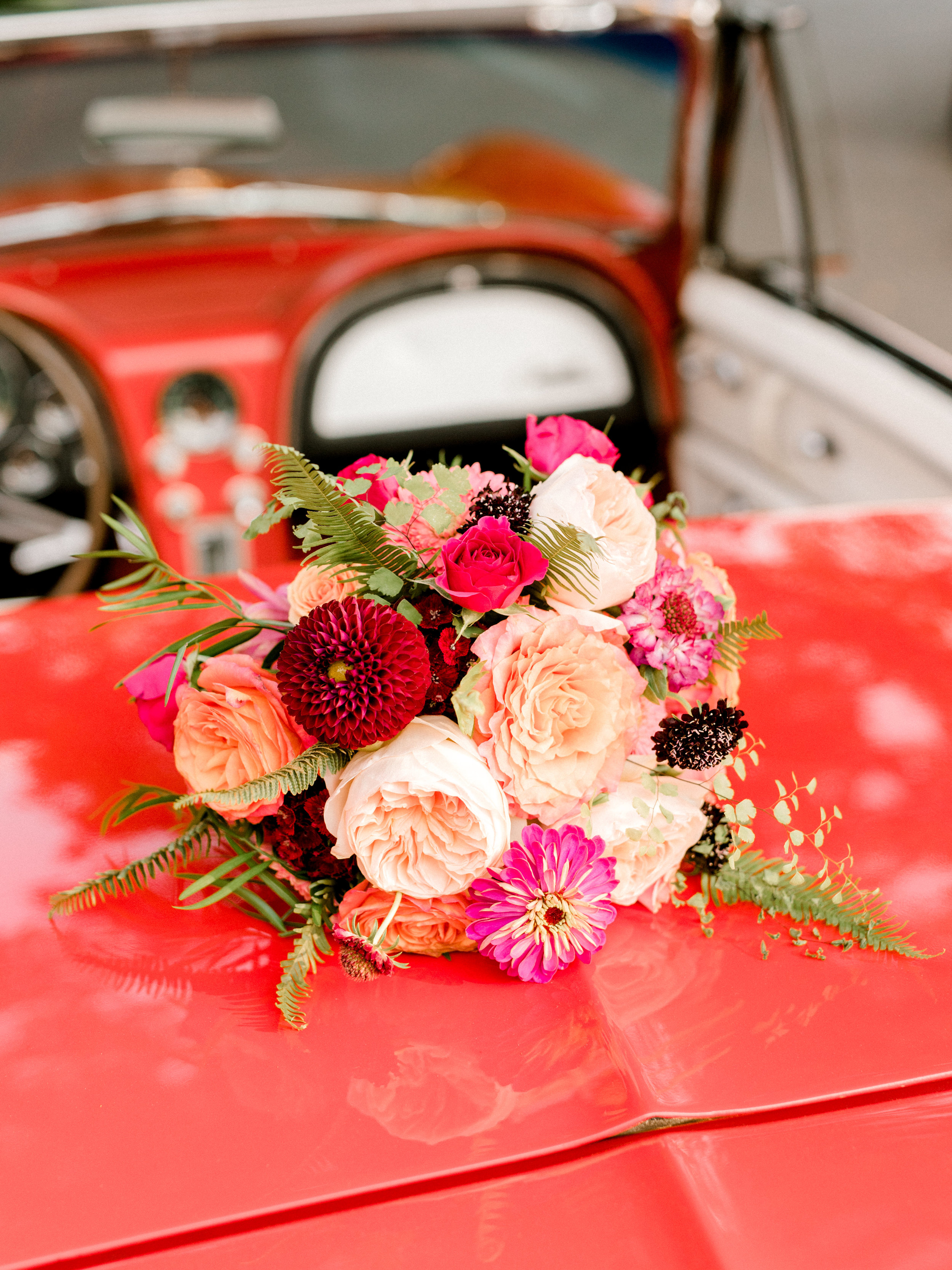 Lindsey and James had the most beautiful and bright flowers from The Pod Shop for their modern summer wedding at Hotel du Village.