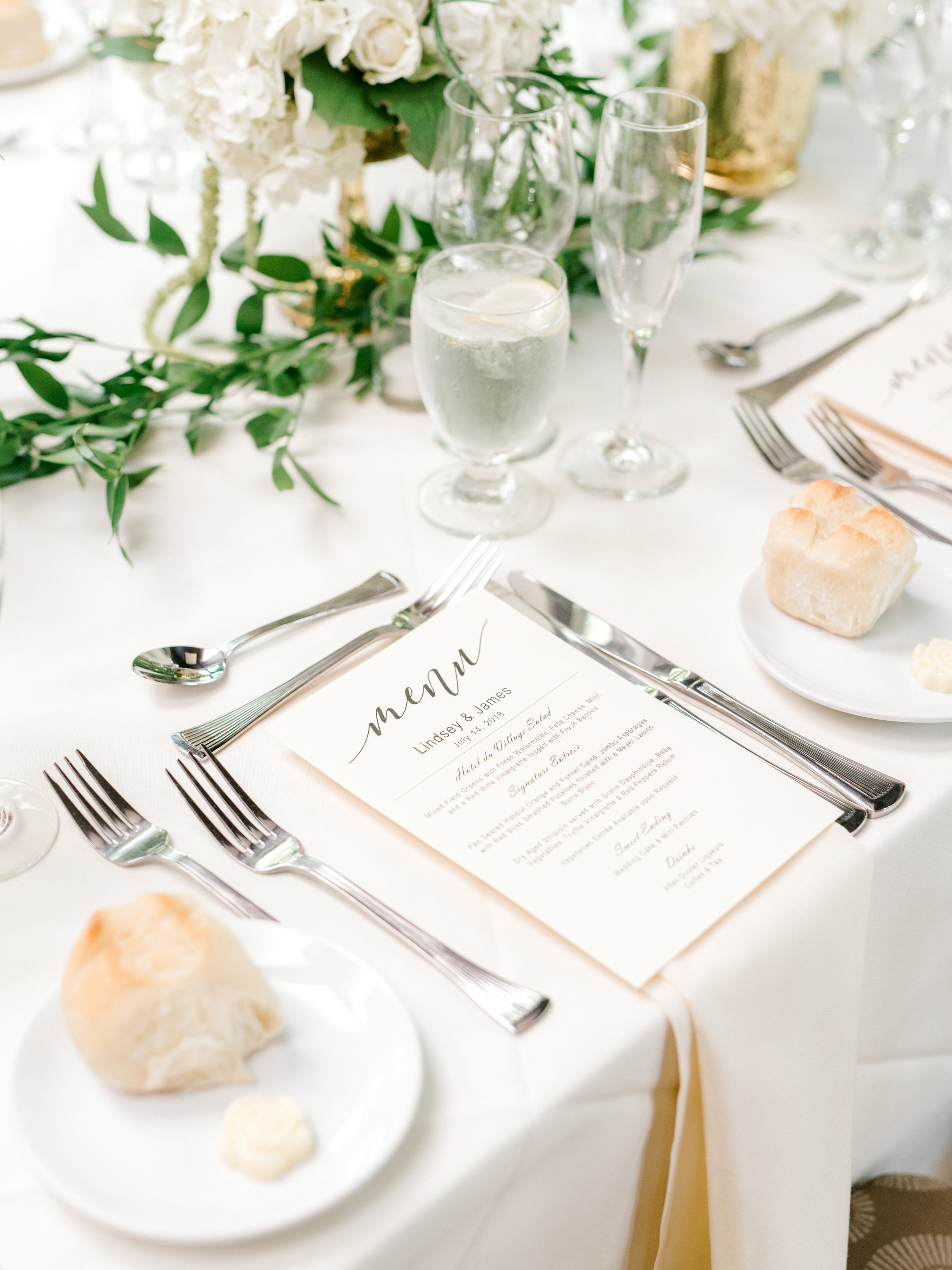 An elegant white and green table setting adds a touch of opulence to this bright and modern summer wedding at Hotel du Village.