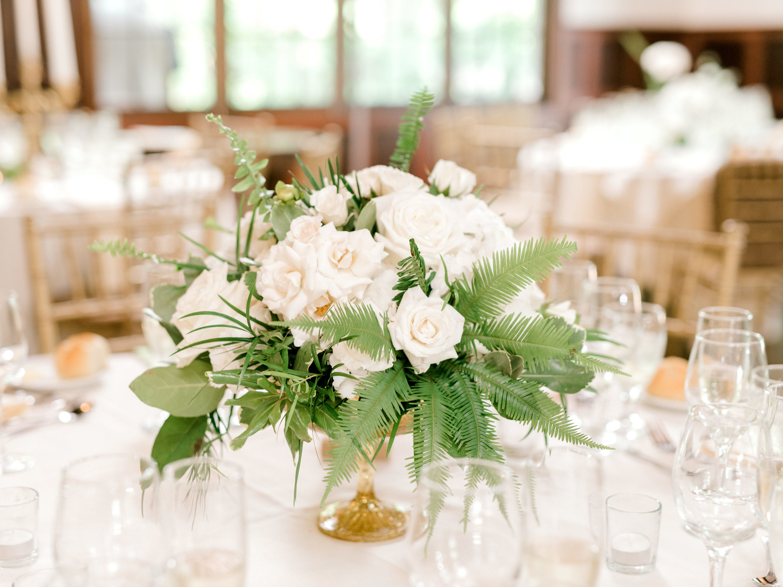 We loved the modern mix of white roses and green ferns to add a bright pop to this elegant and modern summer wedding at Hotel du Village.