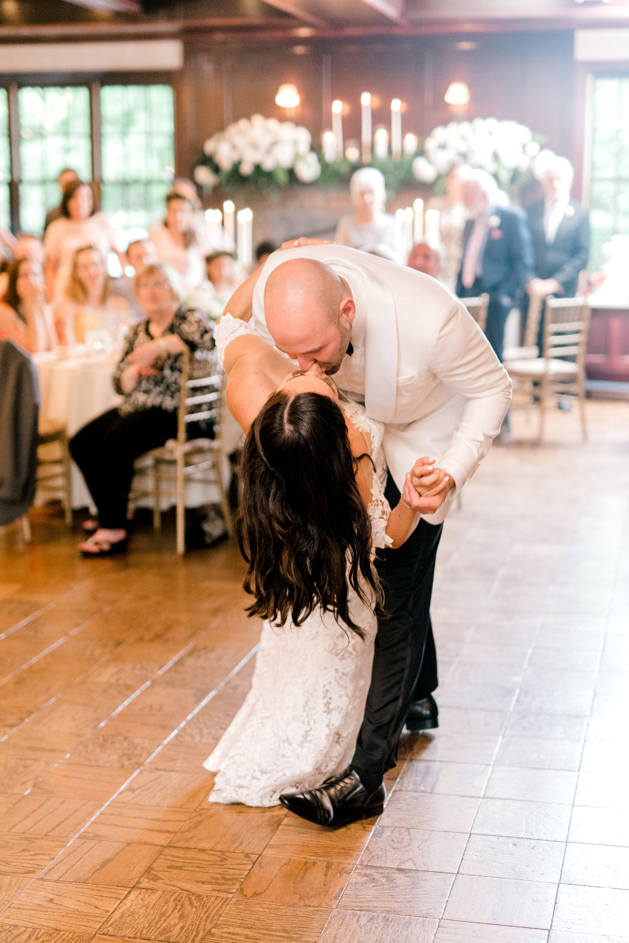 A dramatic dip for their first dance, this modern bright summer wedding at Hotel du Village had so much elegance and we're swooning.