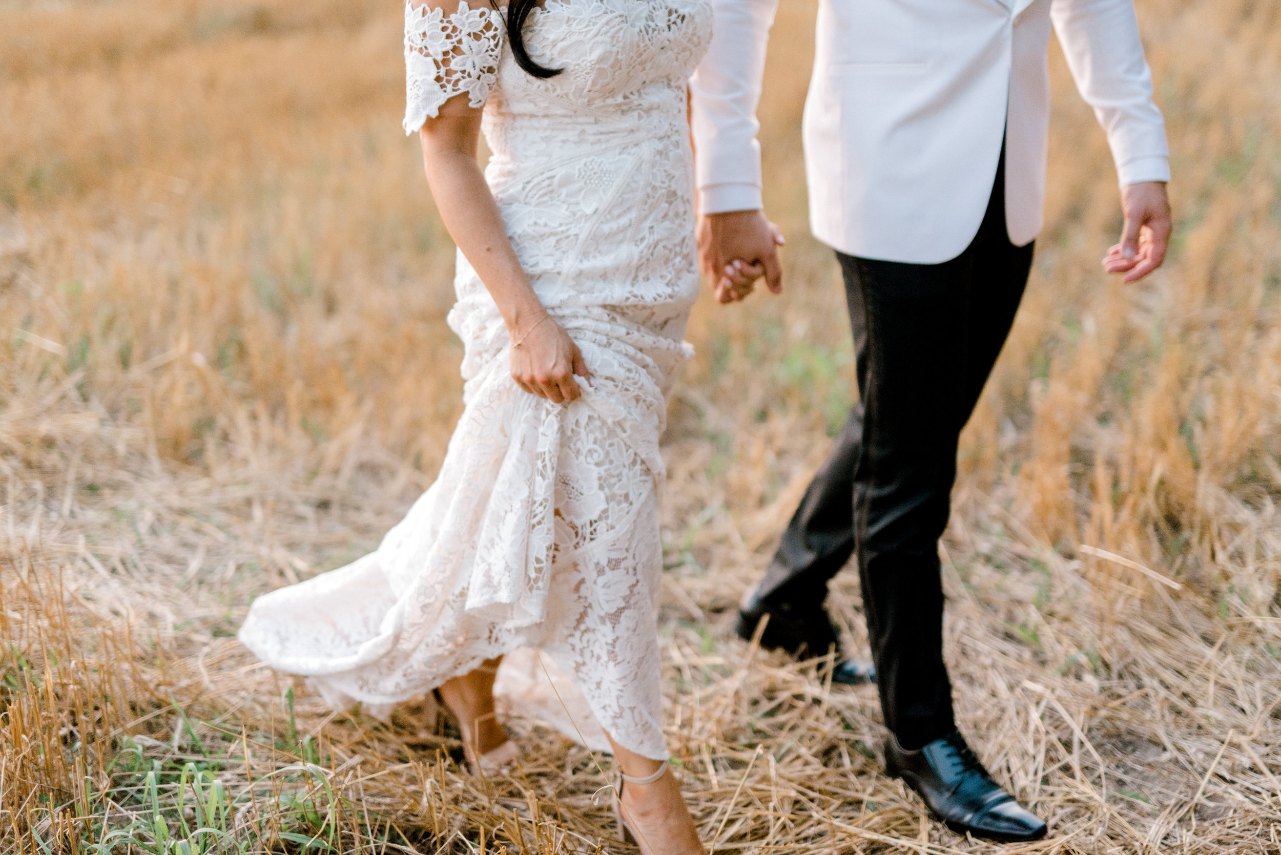 We love the gorgeous sunset out in the wheat field across from Hotel du Village. It's a perfect romantic spot for some end of the evening photos. We also love this classic with a modern twist look in black and white for a summer wedding day.
