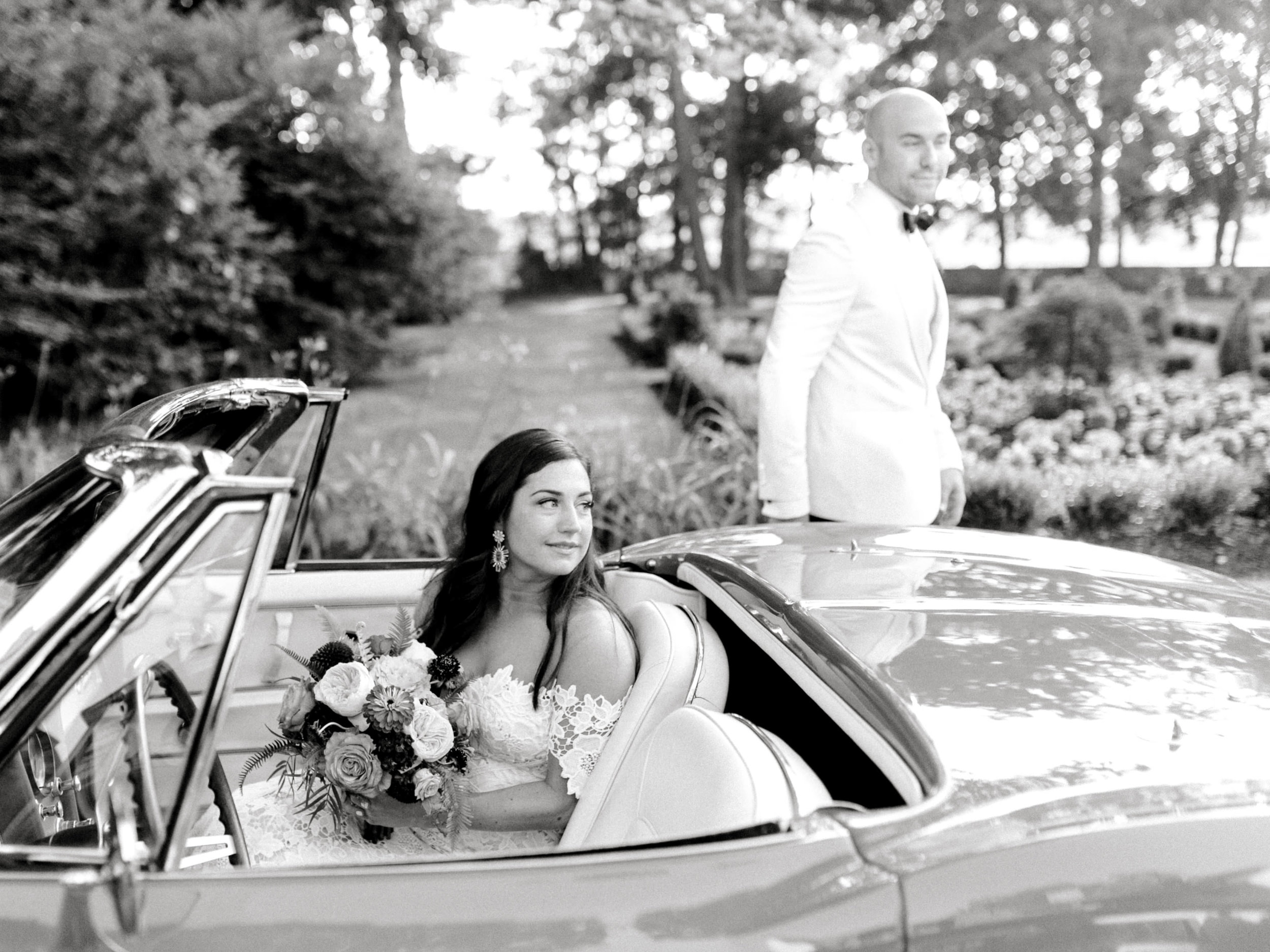 We love the addition of a classic car for your wedding day, like this one on Lindsey and James's modern summer wedding at Hotel du Village.