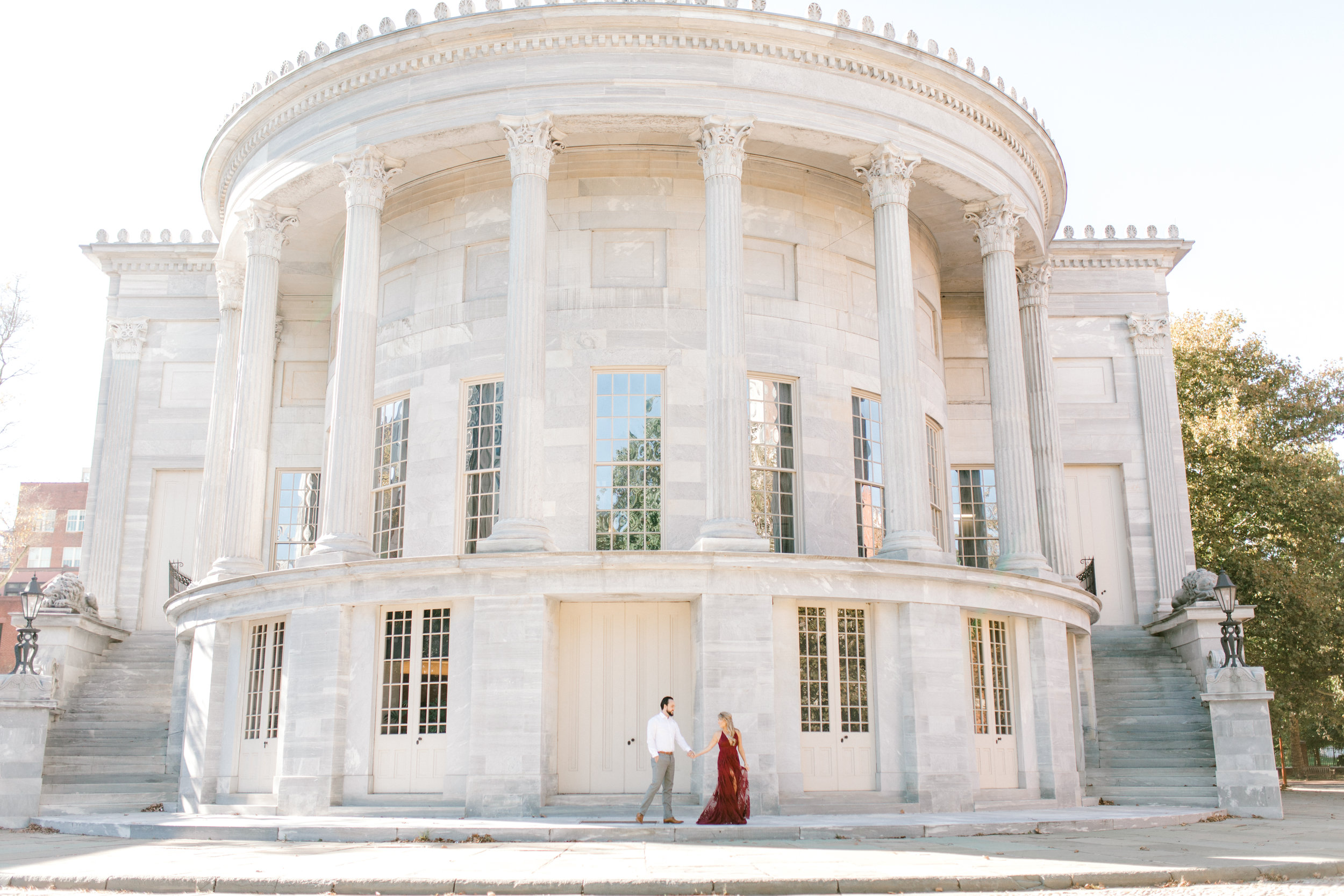 Romantic fall engagement session at the Merchant's Exchange Building in Old City Philadelphia.