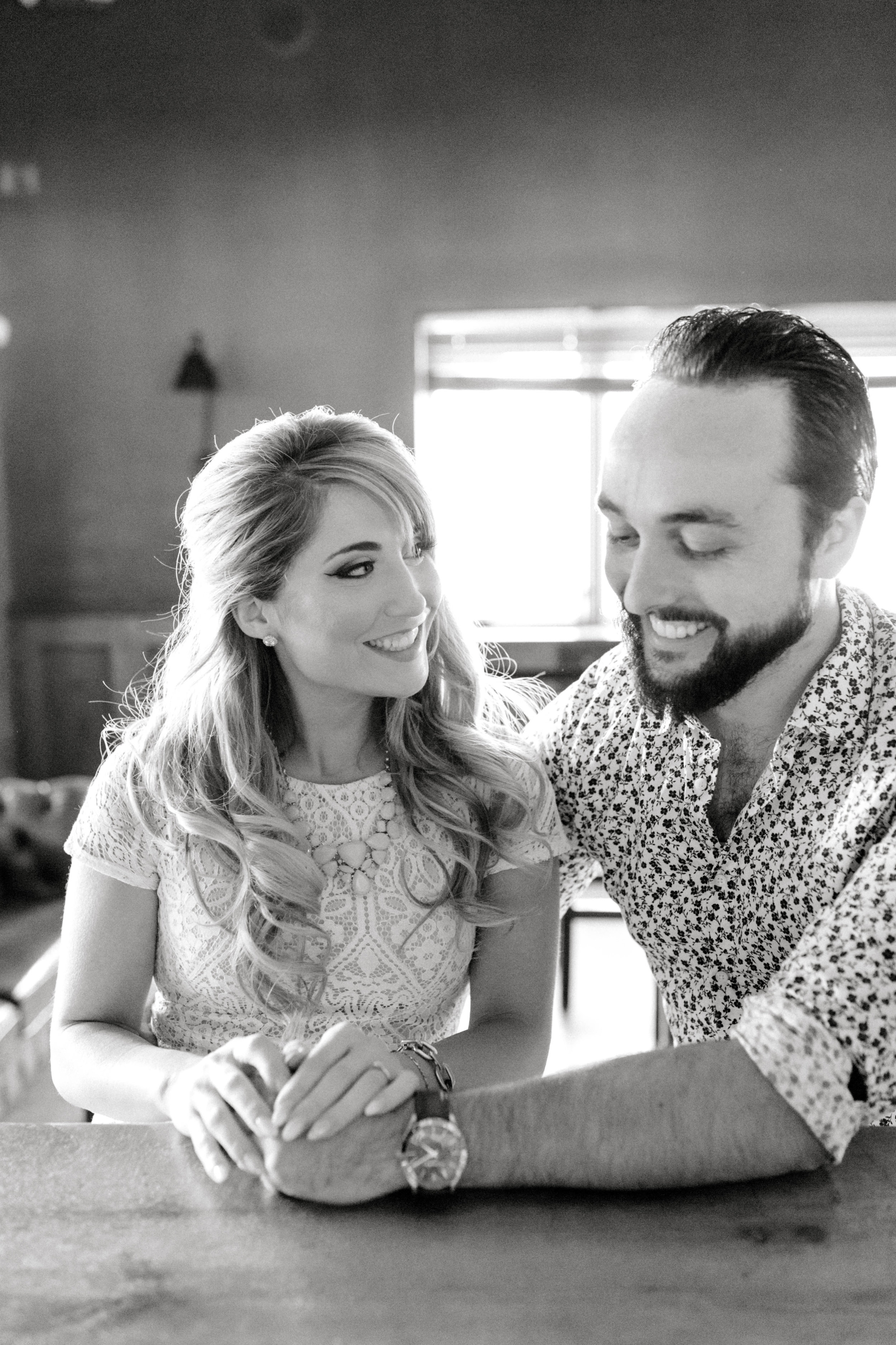 Nikki and Dale cosy up for their romantic engagement session at the bar in Old City Philadelphia.