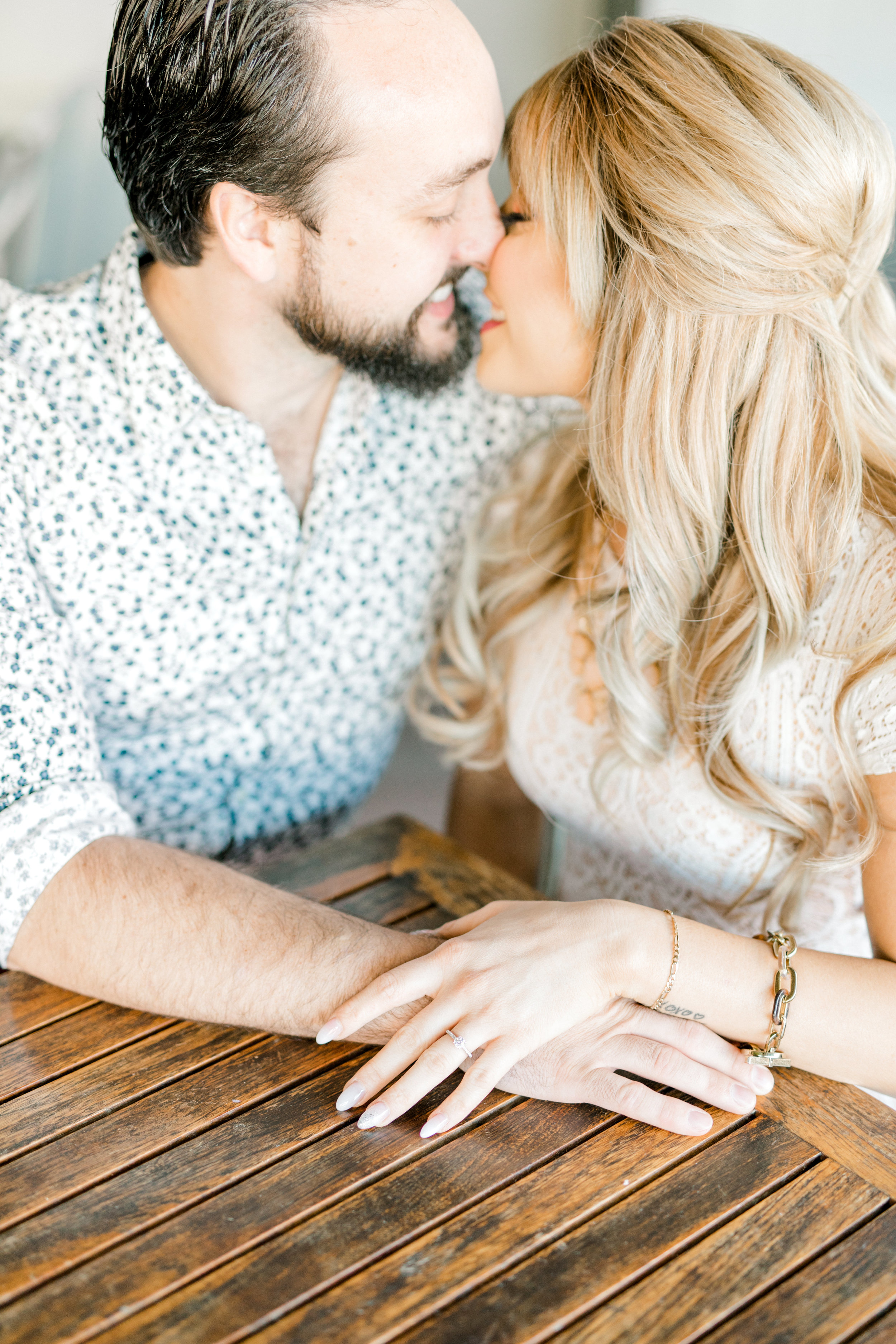 Nikki and Dale get close and romantic on the patio of the Revolution House in Old City, Philadelphia for their fall engagement session.