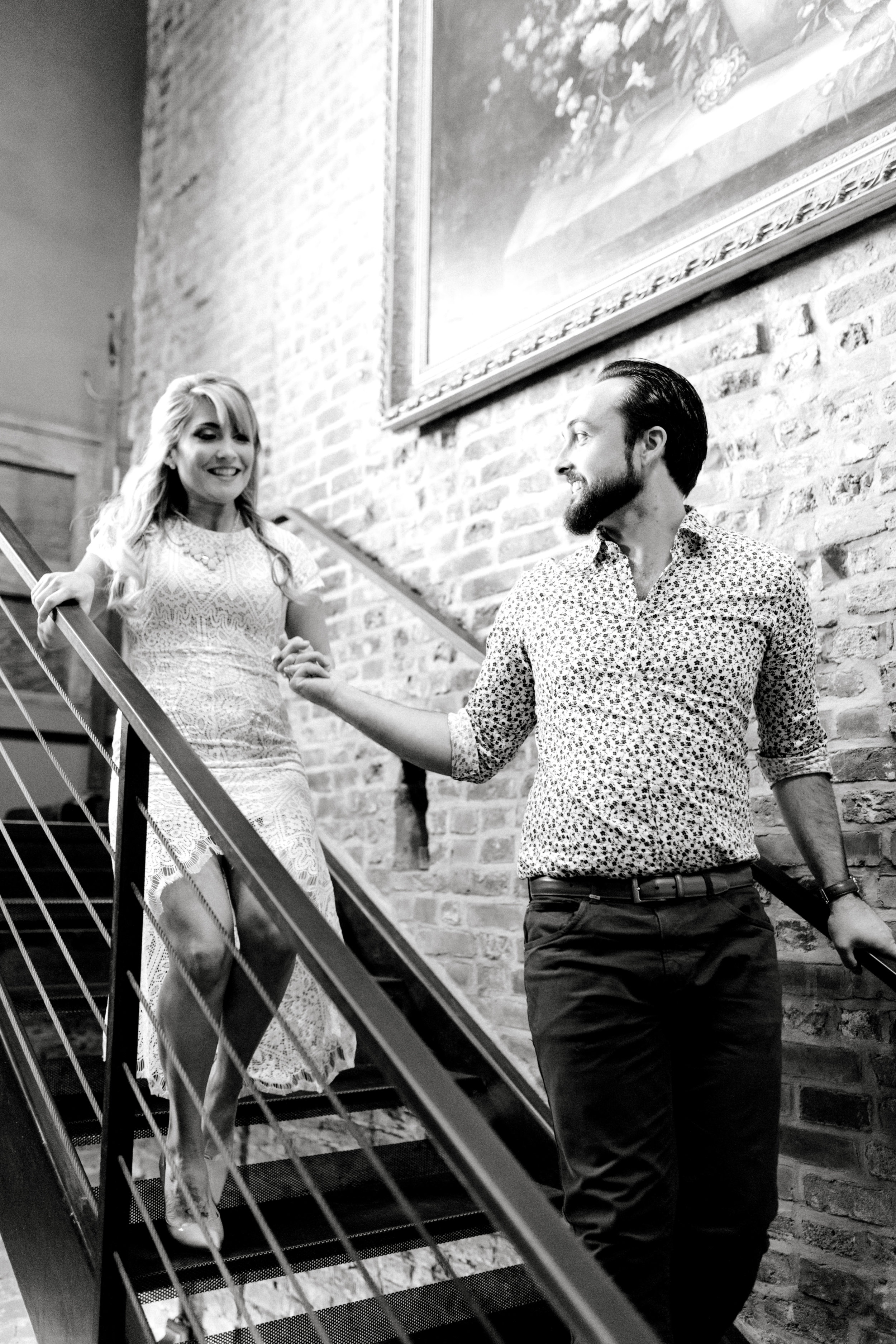 A fun little moment as Dale helps Nikki down the stairs of the Revolution House bar in Old City, Philadelphia for their bright and romantic engagement session.