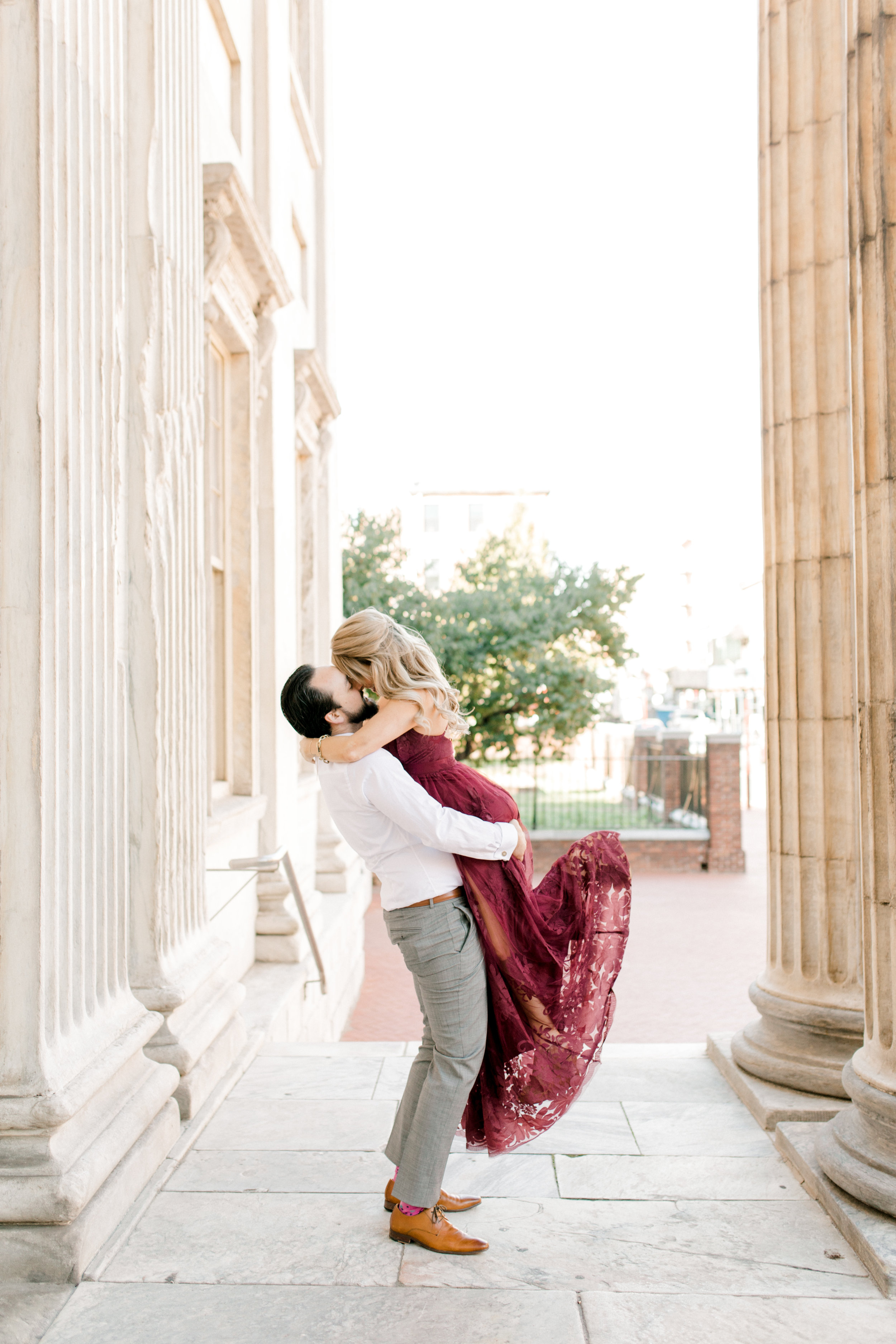 A romantic gesture, Dale lifts Nikki in the air for their bright fall engagement session in Old City, Philadelphia.