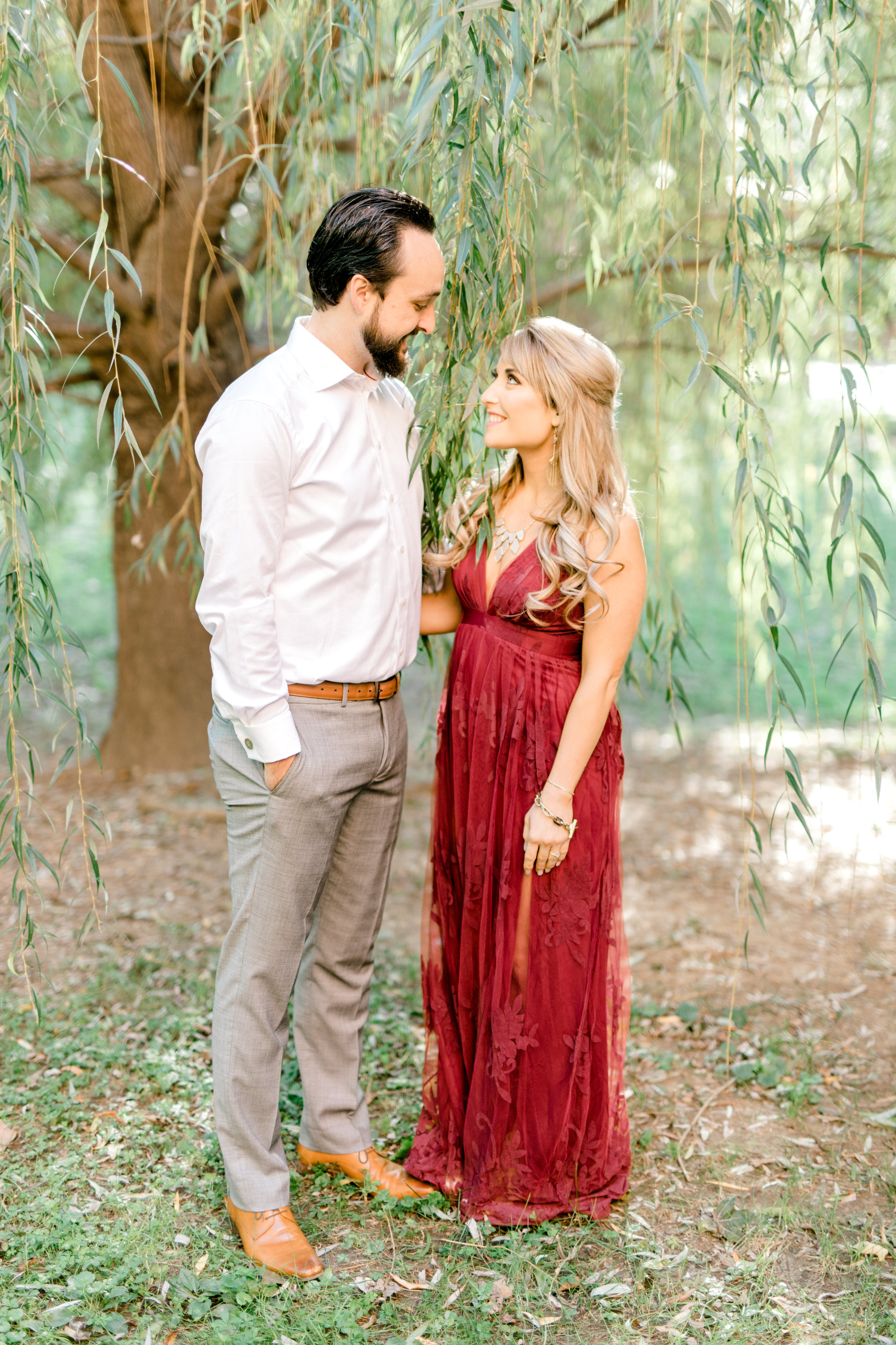 We loved the romantic look of Nikki's burgundy dress with Dale's white and grey outfit for their bright fall engagement session in Old City, Philadelphia.