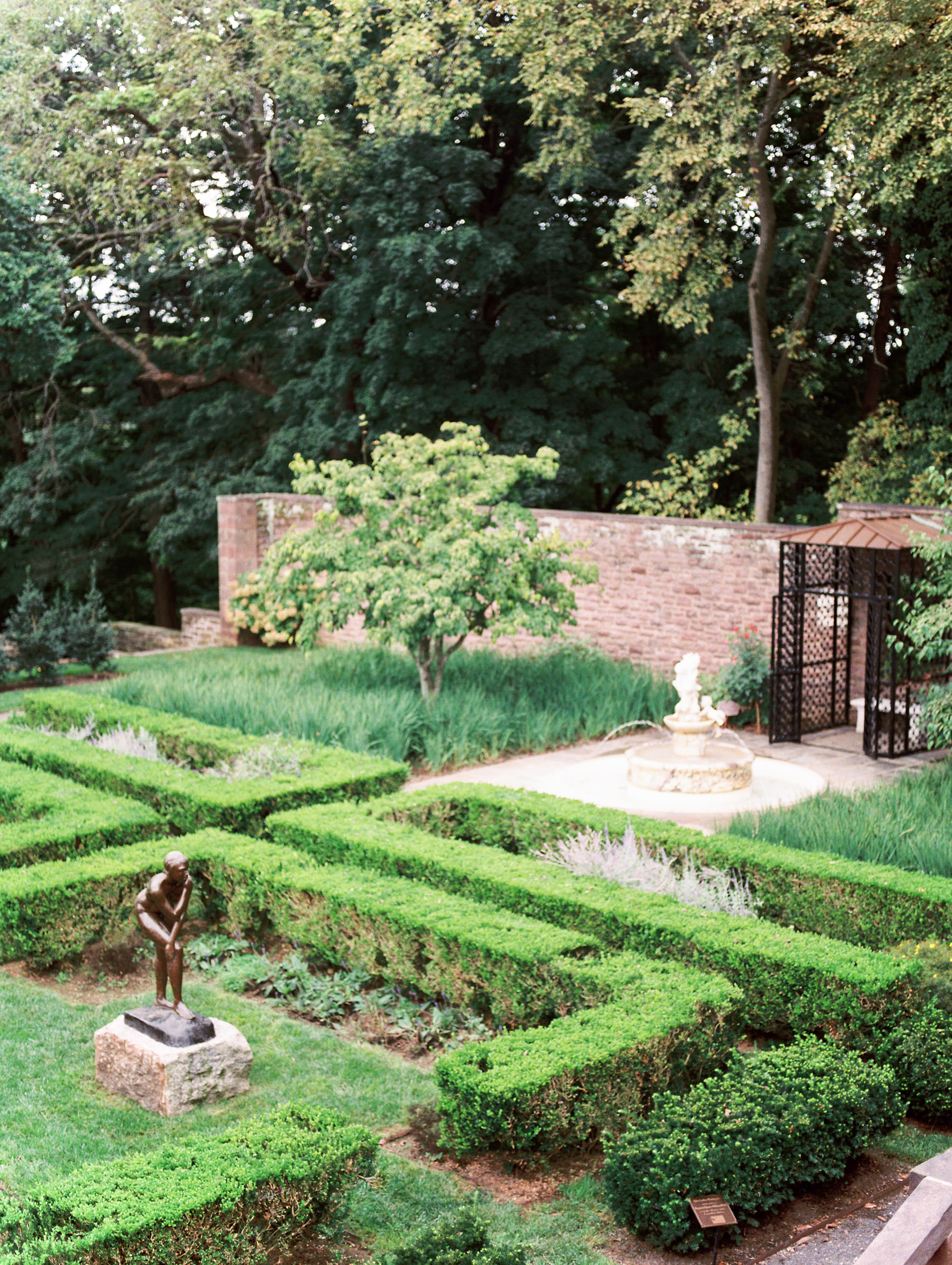 We loved how we felt like we were in France with the sculpted garden greenery from this bright boho chic Tyler Gardens wedding in Bucks County