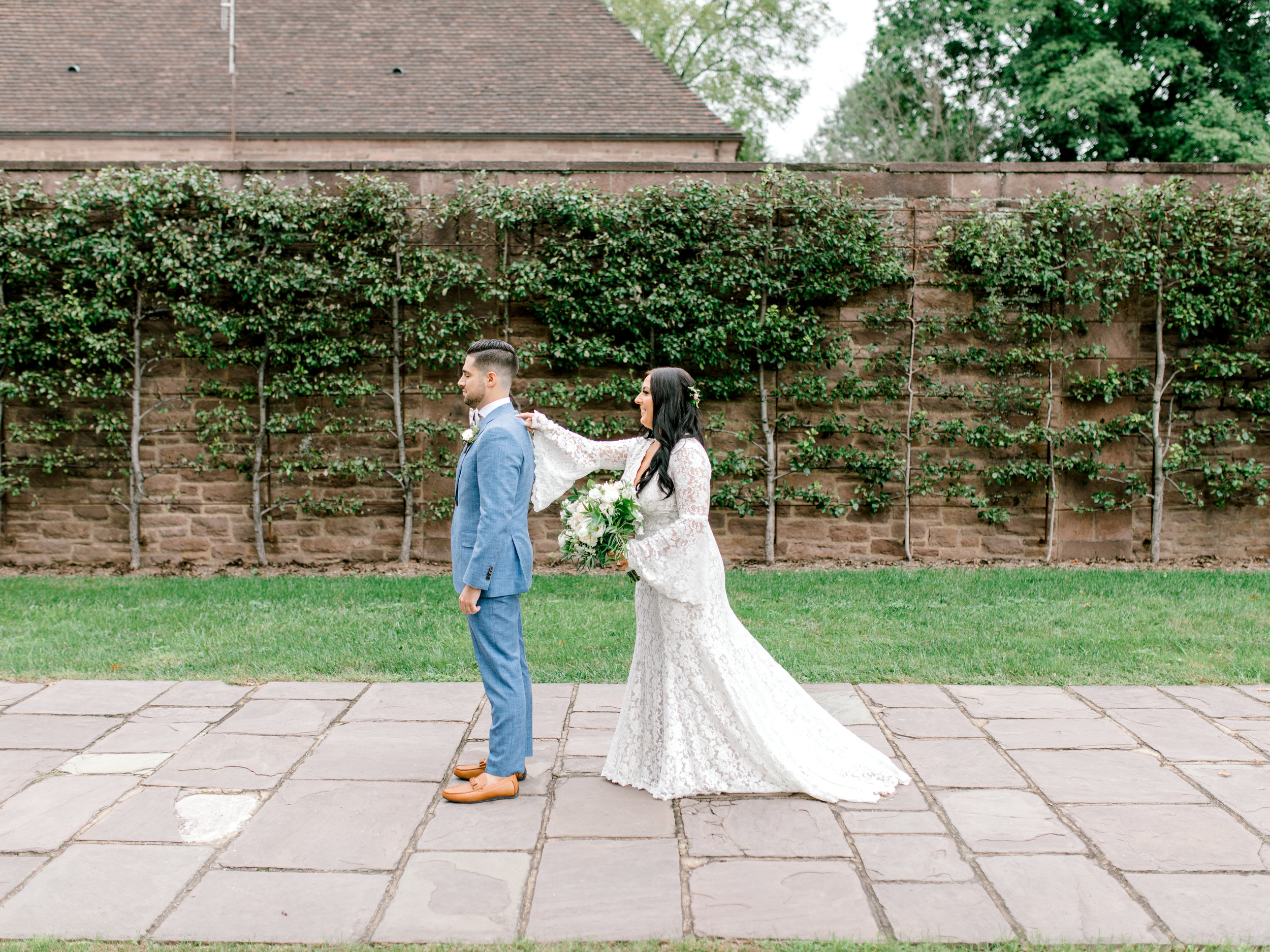 In the garden, just moments before their first look at Alicia and Mike's bright boho chic Tyler Gardens wedding in Bucks County