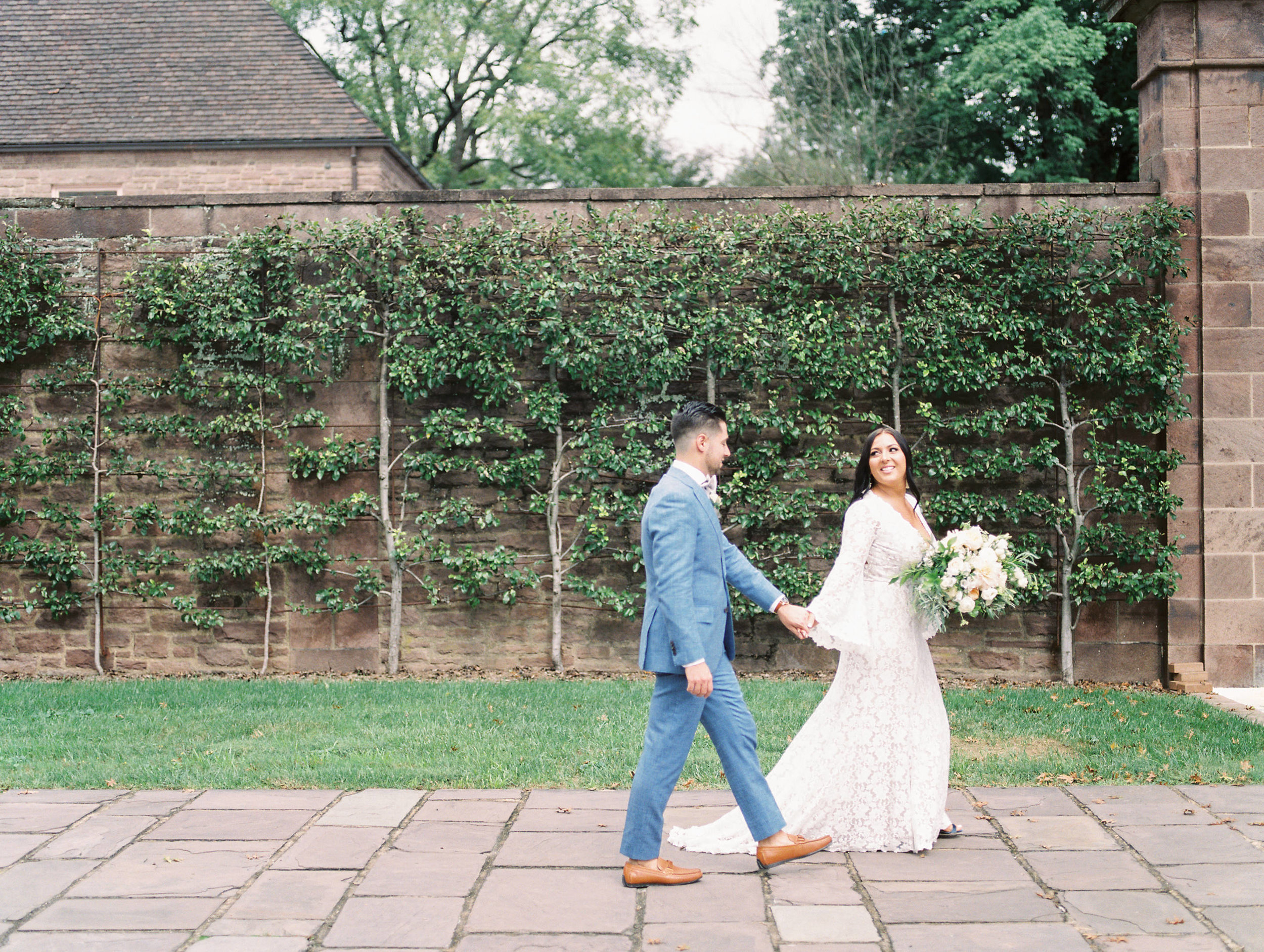 Walk with me, Alicia leads Mike into their bright boho chic Tyler Gardens wedding in Bucks County