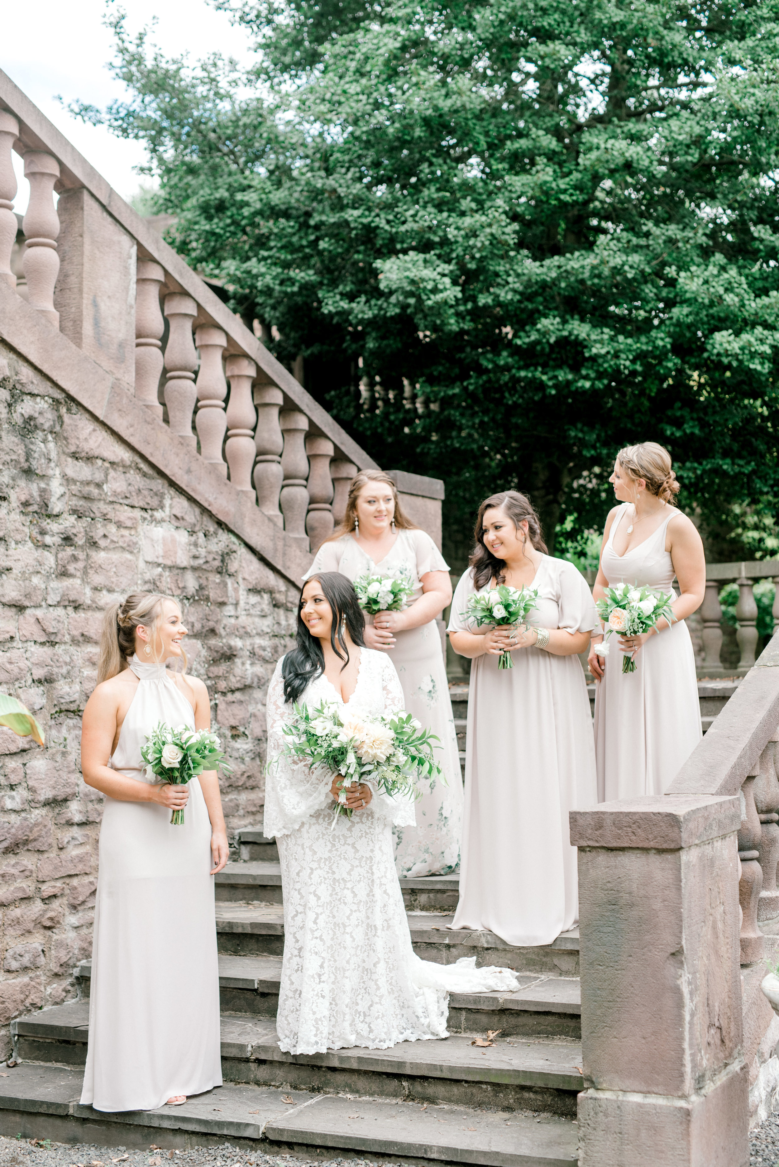 These bridesmaids in their shades of nude and gray looked absolutely from a fairytale for this bright boho chic Tyler Gardens wedding in Bucks County