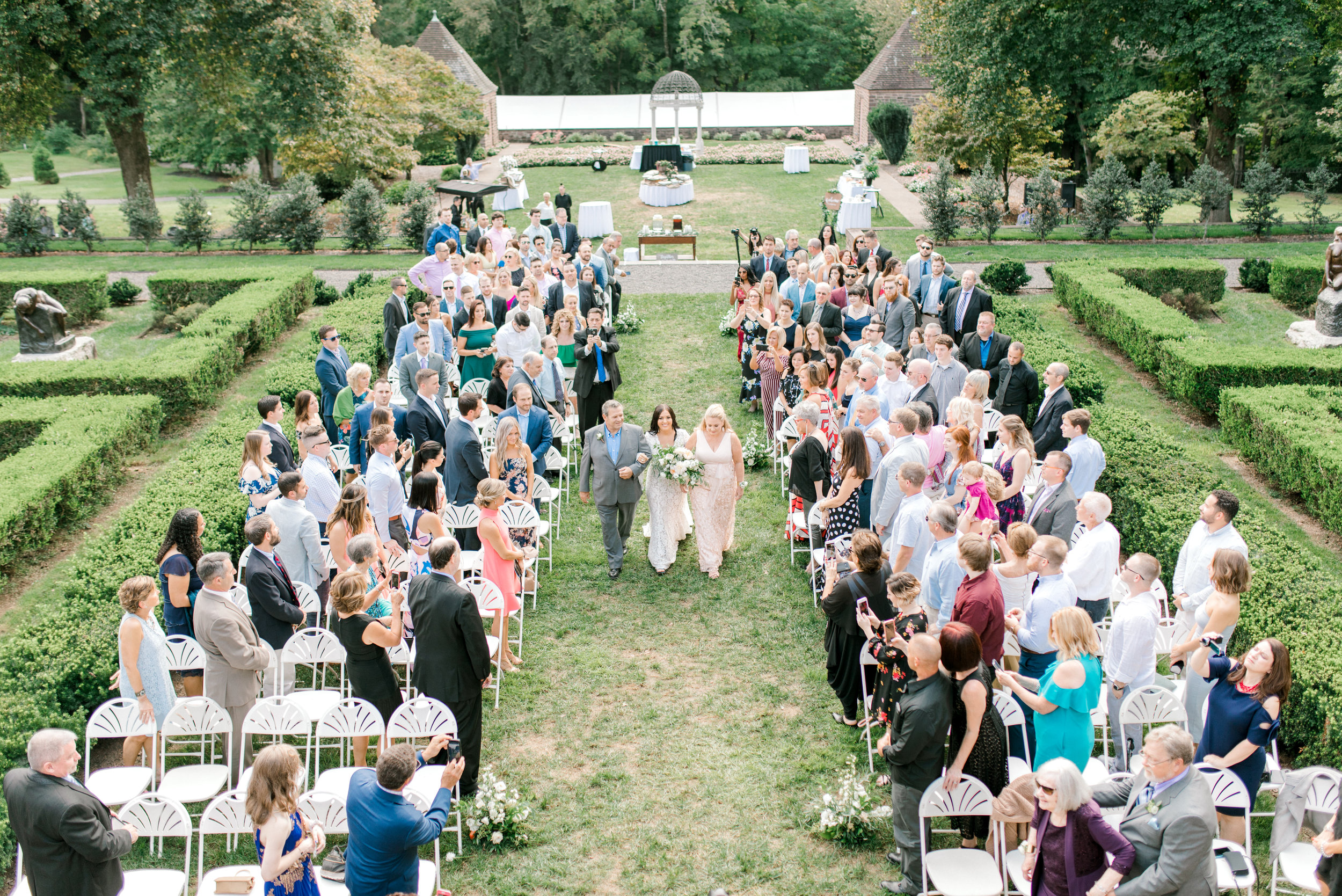 This garden ceremony gave us all the feels as Alicia walked down the aisle at her bright boho chic Tyler Gardens wedding in Bucks County