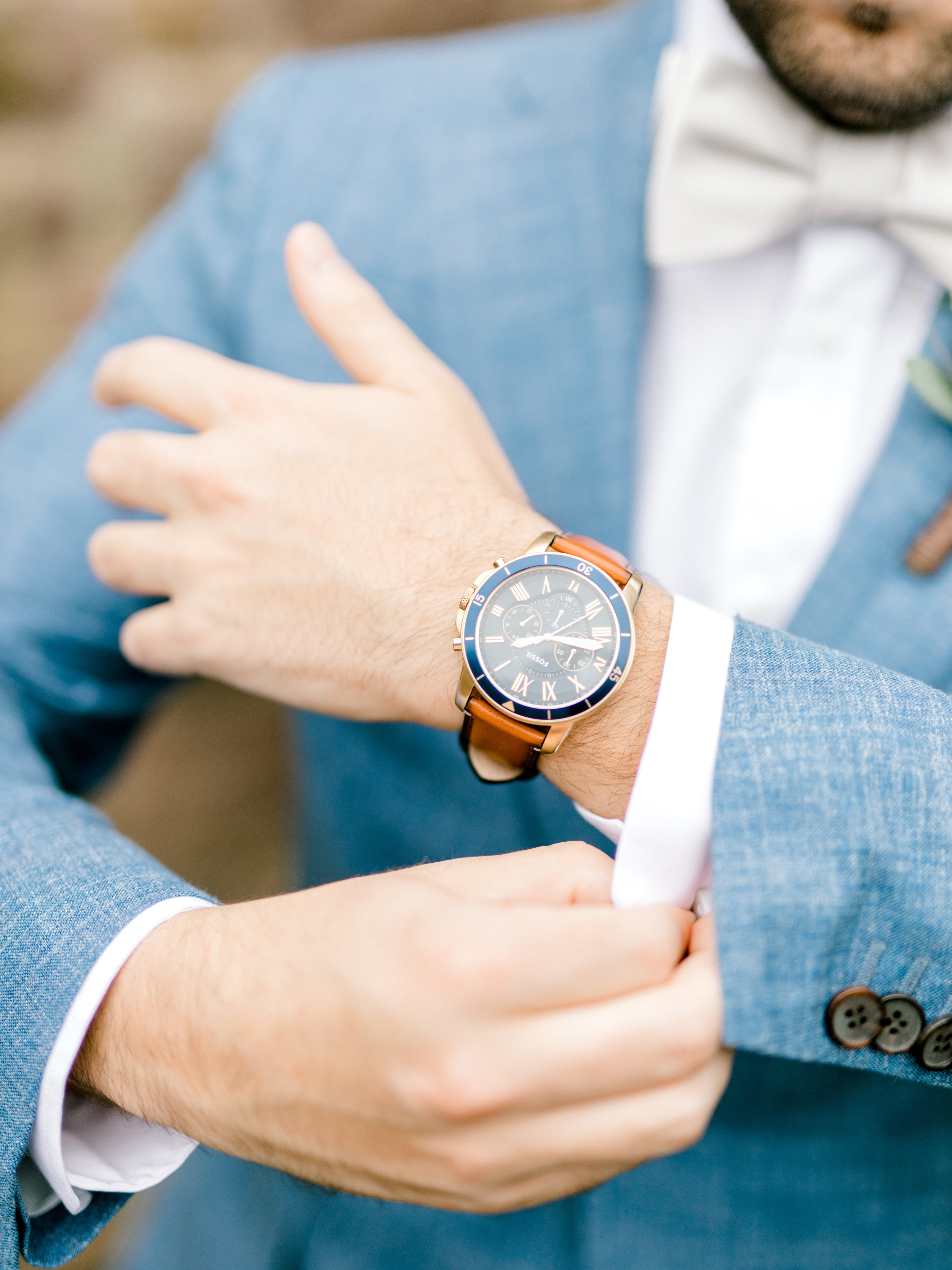 I'm loving this stylish watch with leather strap mixed with Mike's light blue suit for his bright boho chic Tyler Gardens wedding in Bucks County
