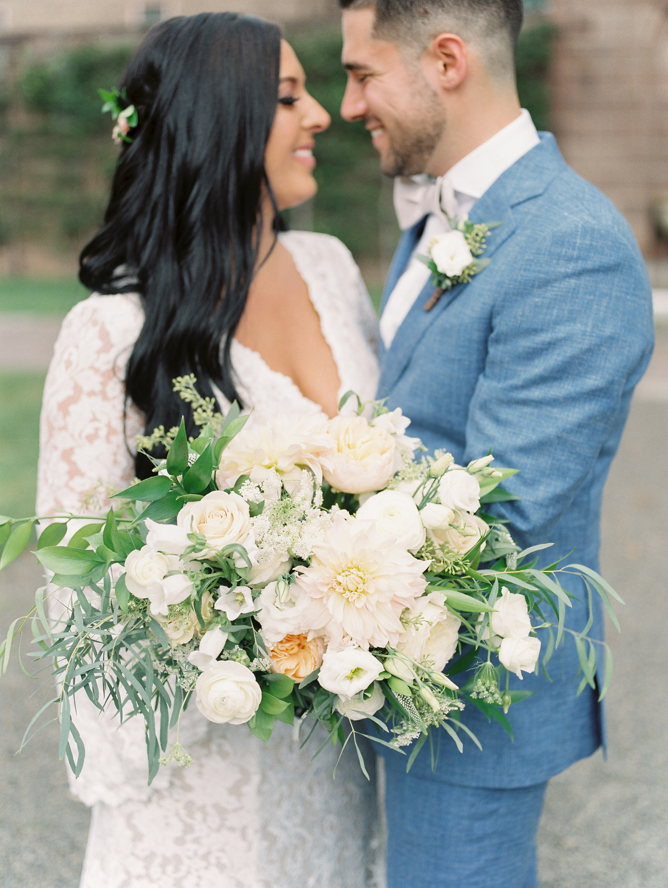 A totally gorgeous wild white, blush, and green bouquet by Maura Rose Events from this bright boho chic Tyler Gardens wedding in Bucks County, plus we dig this light blue suit