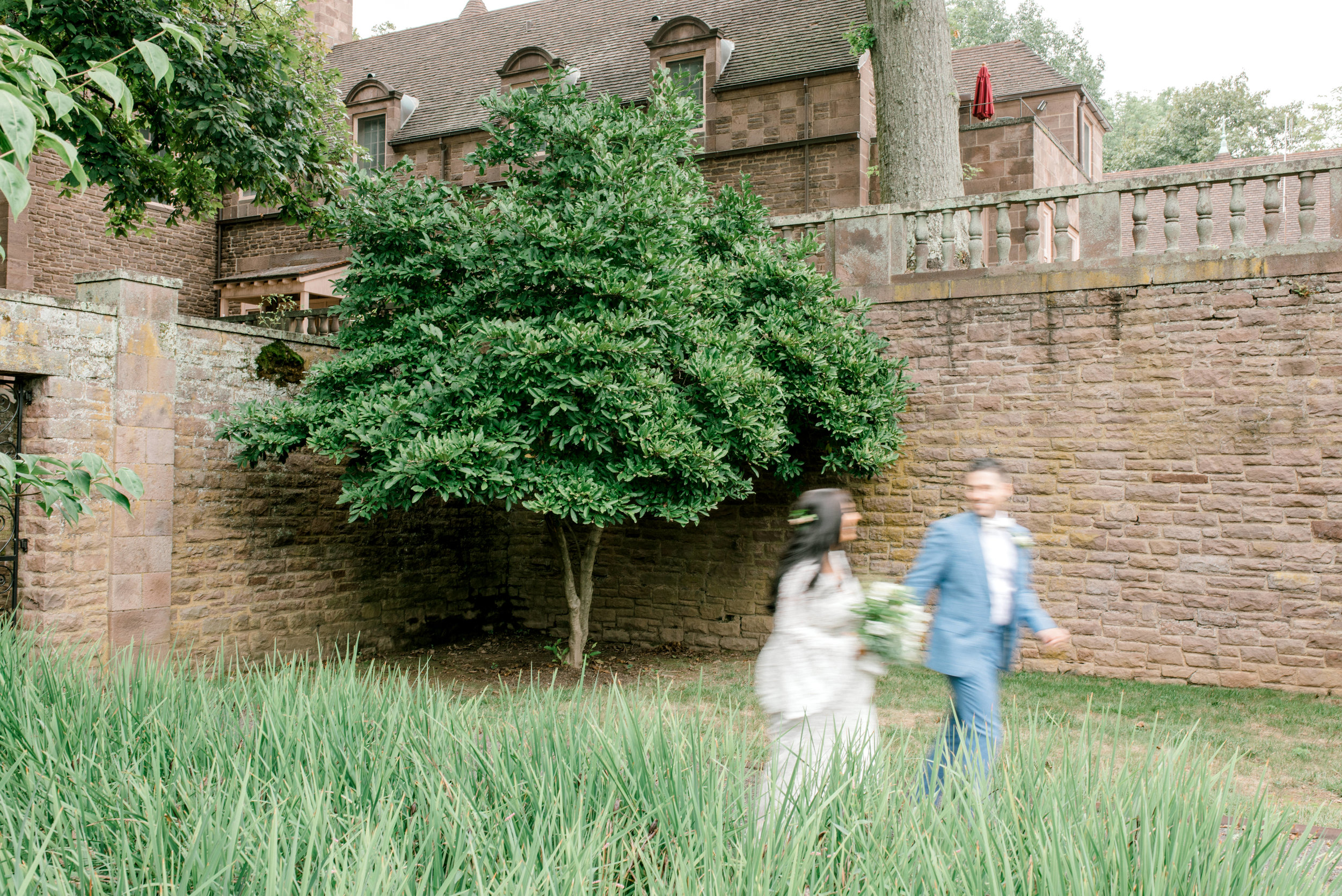 Running together through the garden, these two made a romantic moment happen at their bright boho chic Tyler Gardens wedding in Bucks County