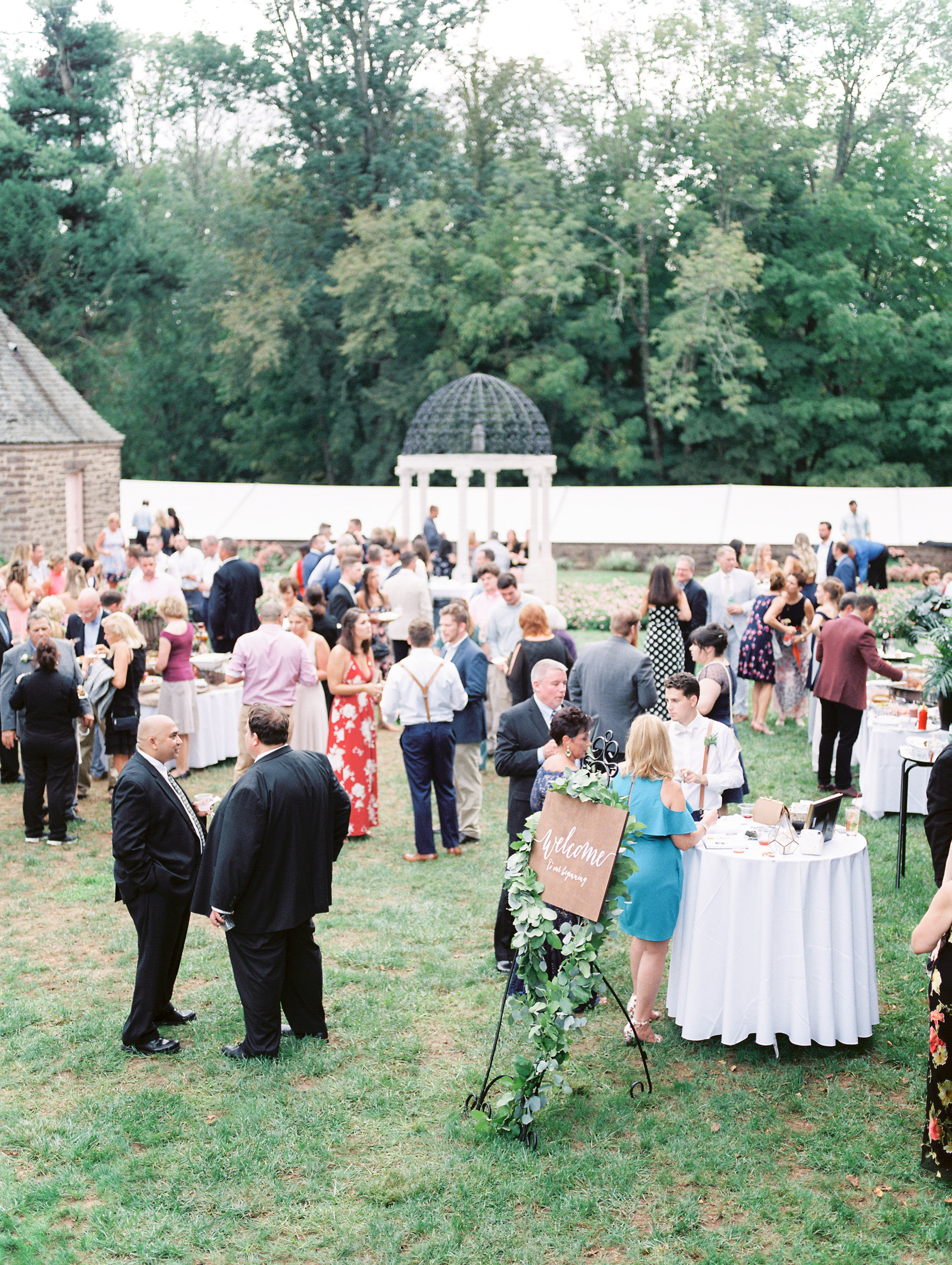 Cocktail hour in the garden is the right way to do it, we got all the European vibes from this bright boho chic Tyler Gardens wedding in Bucks County