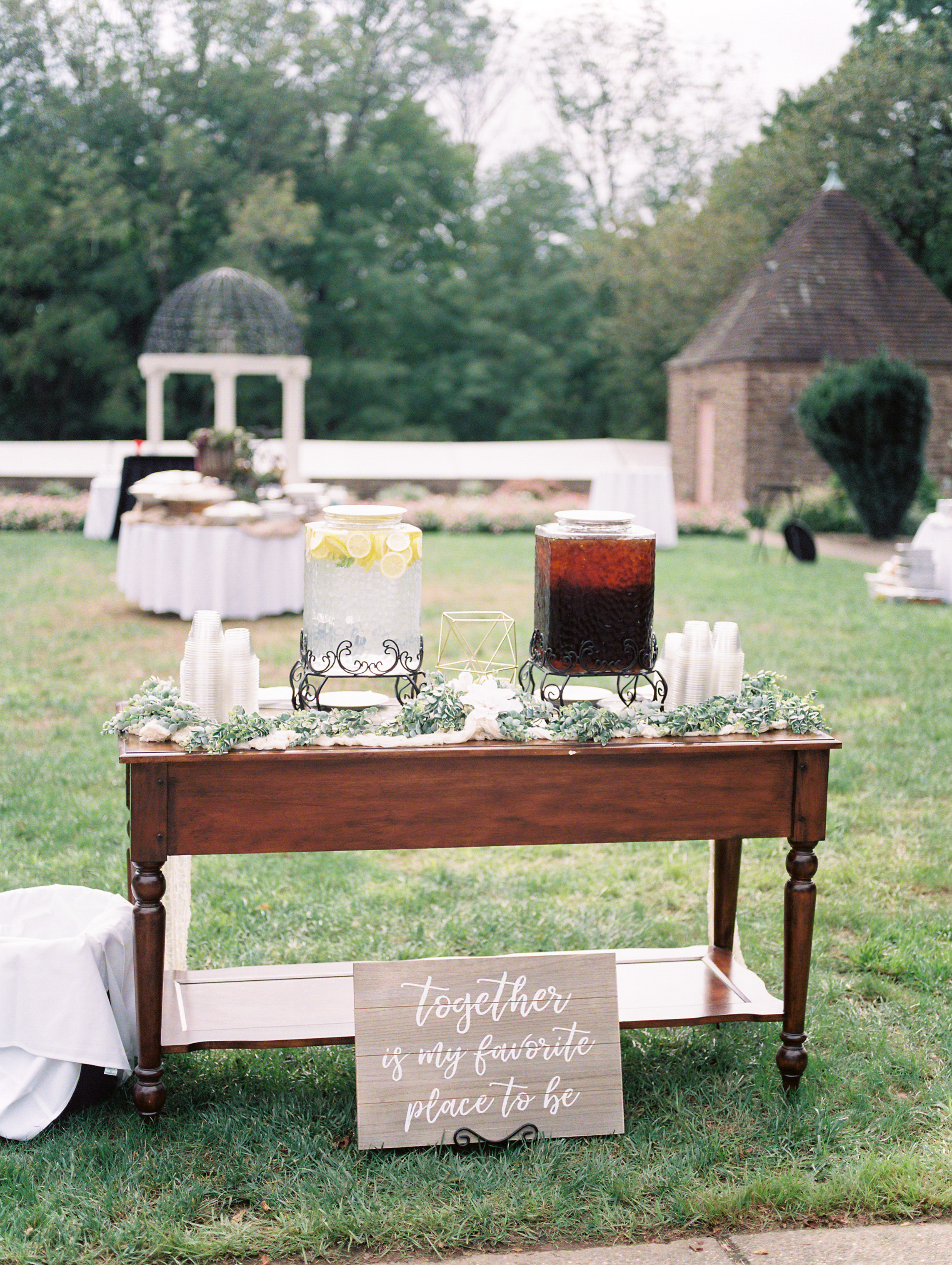 Refreshments await at this elegant cocktail hour set-up in the garden from this bright boho chic Tyler Gardens wedding in Bucks County