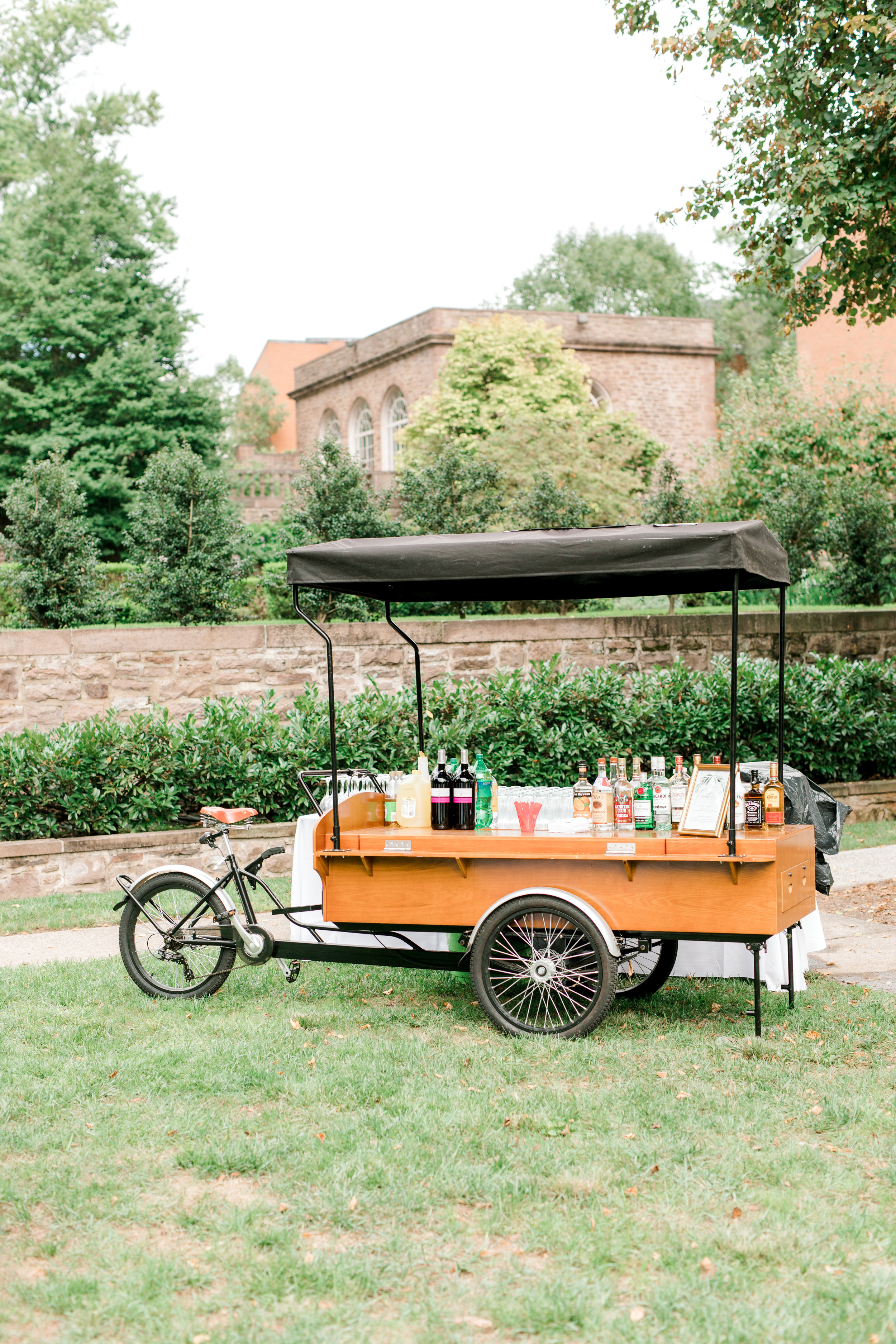 A vintage beverage cart that could be straight from Italy from this bright boho chic Tyler Gardens wedding in Bucks County