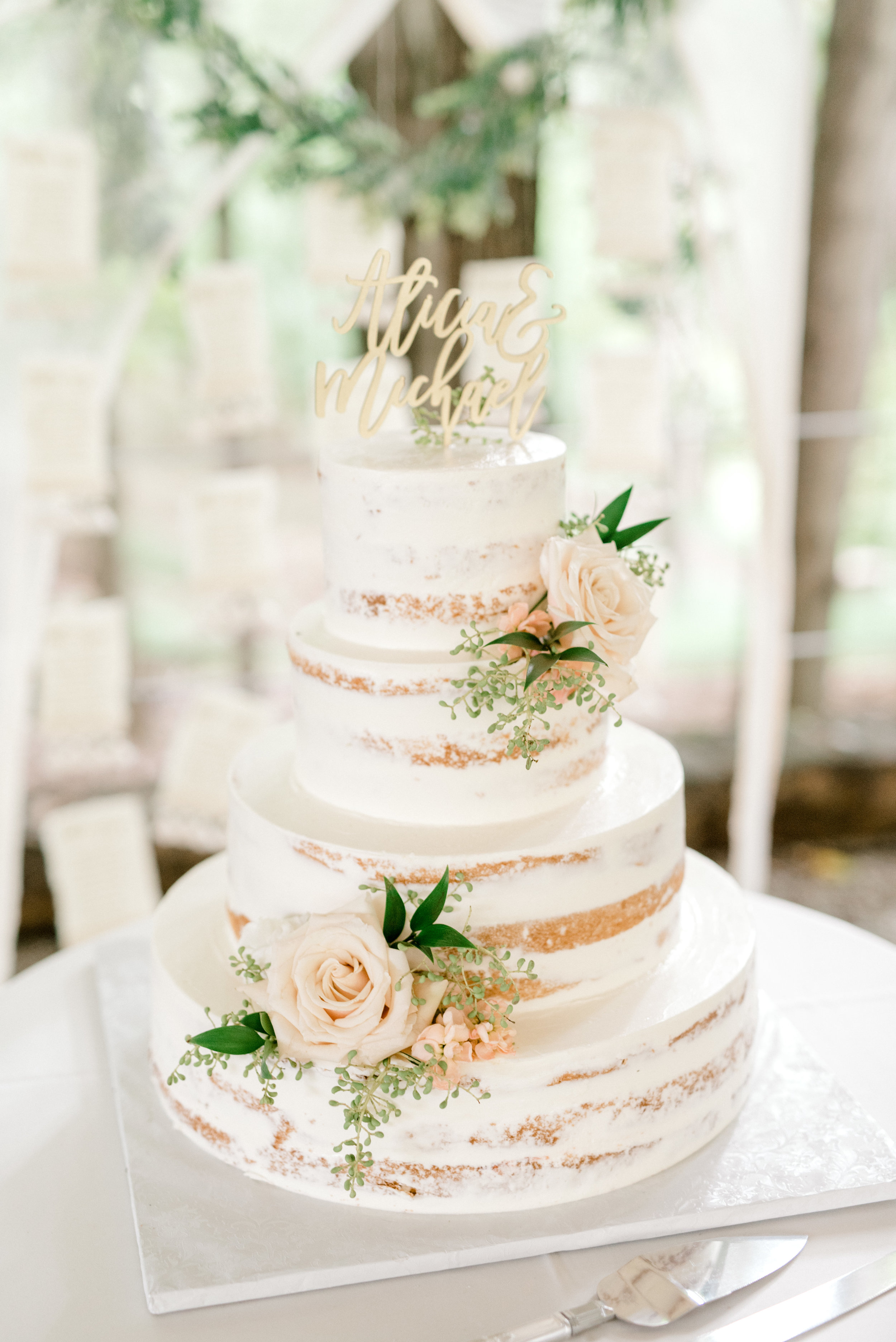 We adore the simplicity and elegance of this white half naked cake finished with a laser cut cake topper at this bright boho chic Tyler Gardens wedding in Bucks County