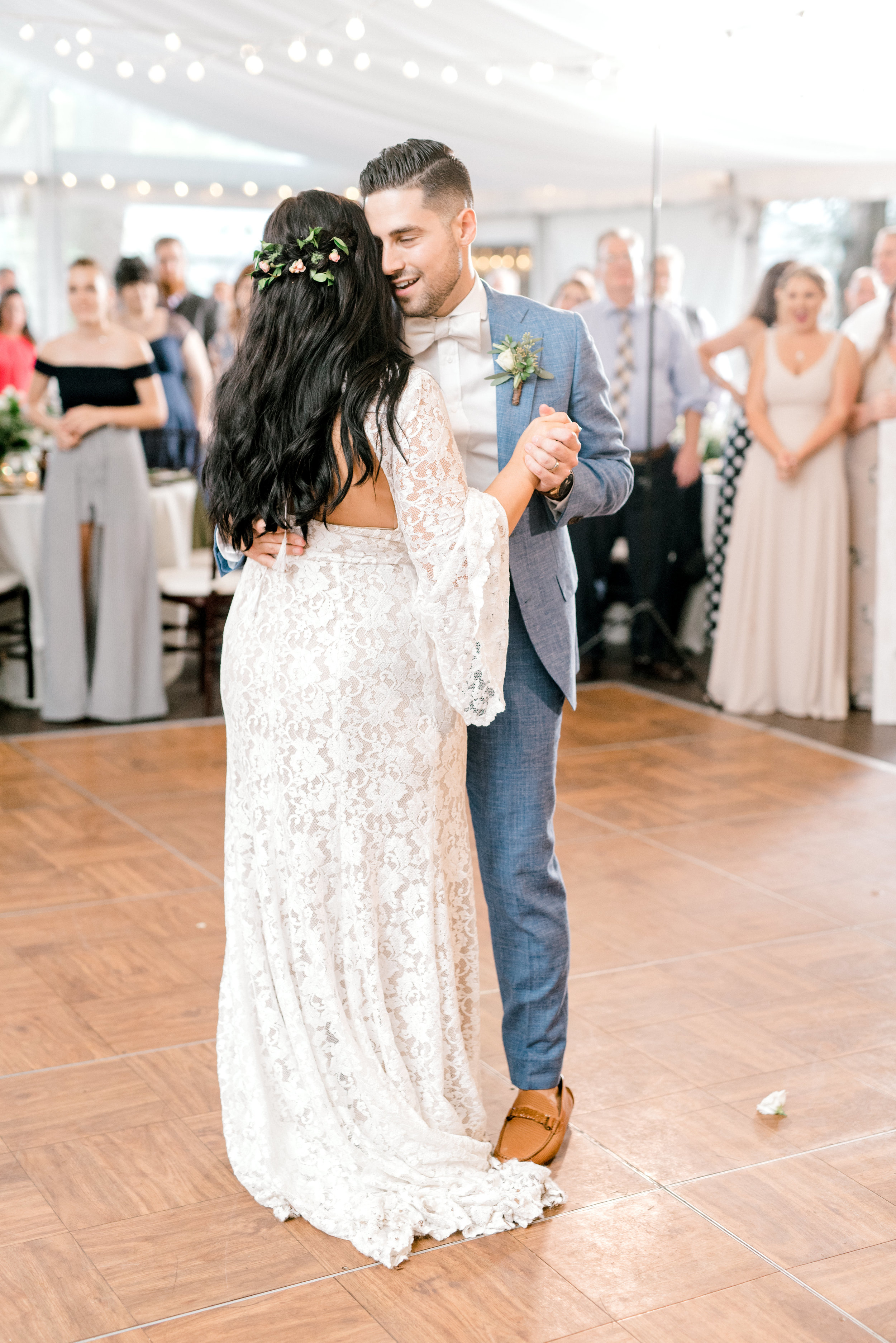 A first dance to remember as Alicia and Mike hold each other on the dance floor at their bright boho chic Tyler Gardens wedding in Bucks County