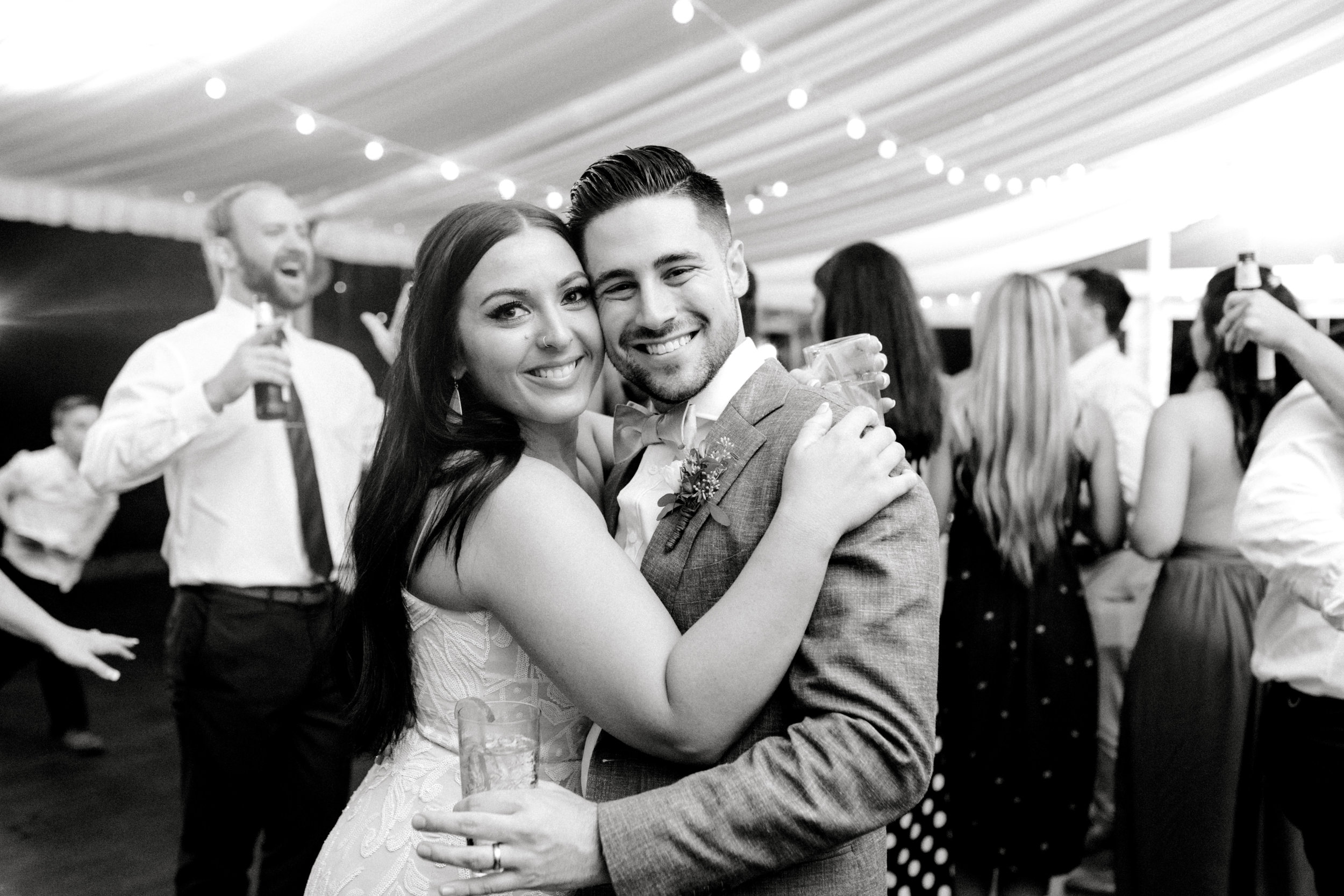 All smiles for this happy couple as they pose for one more photo at the reception of their bright boho chic Tyler Gardens wedding in Bucks County