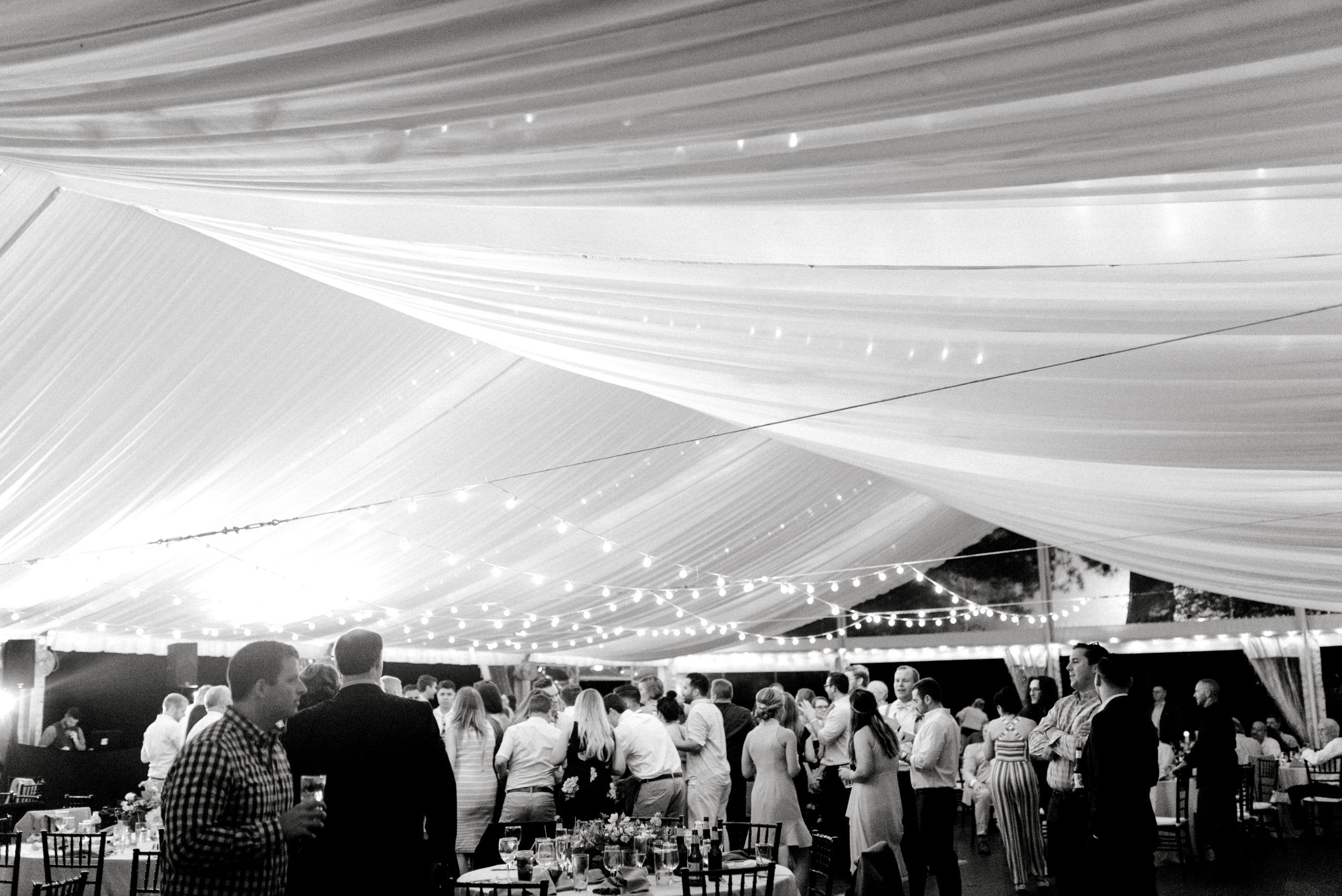 The party went on late into the night under the lighted tent for this bright boho chic Tyler Gardens wedding in Bucks County