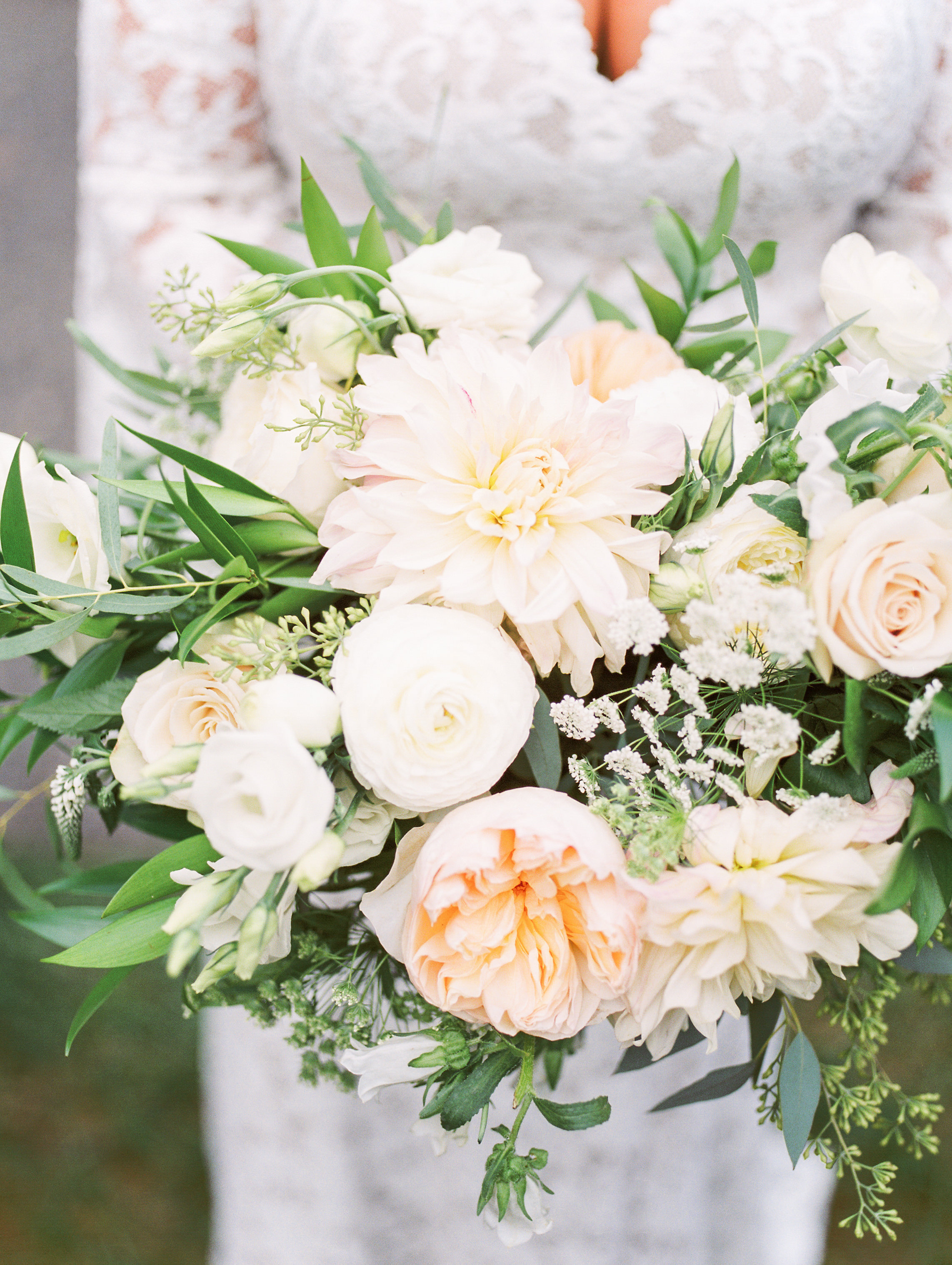 A close up of these grogeous light flowers in shades of white and blush with plenty of greenery from this bright boho chic Tyler Gardens wedding in Bucks County