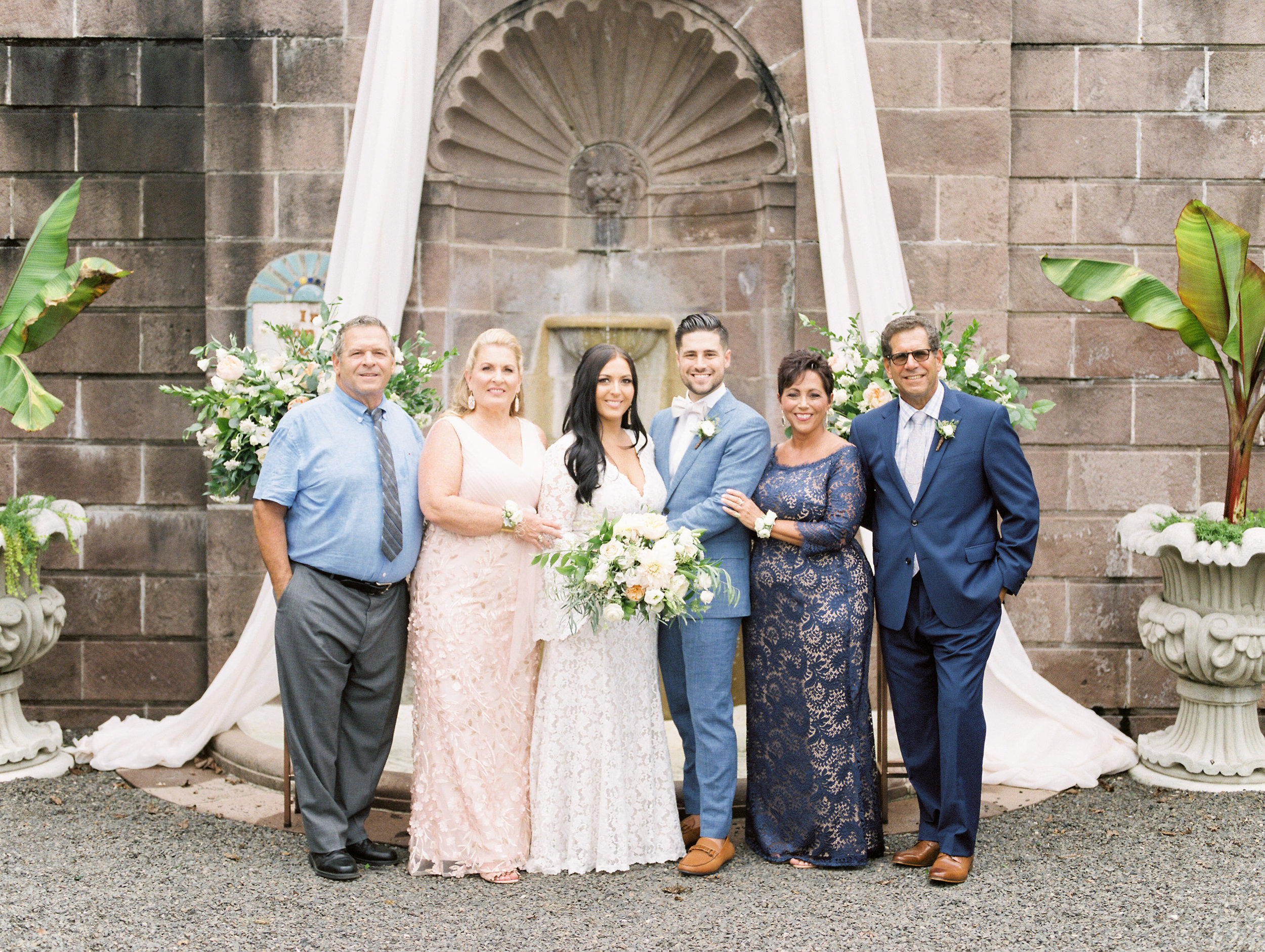 The beautiful stonework and arches from the bright boho chic Tyler Gardens wedding in Bucks County make for the best family portraits