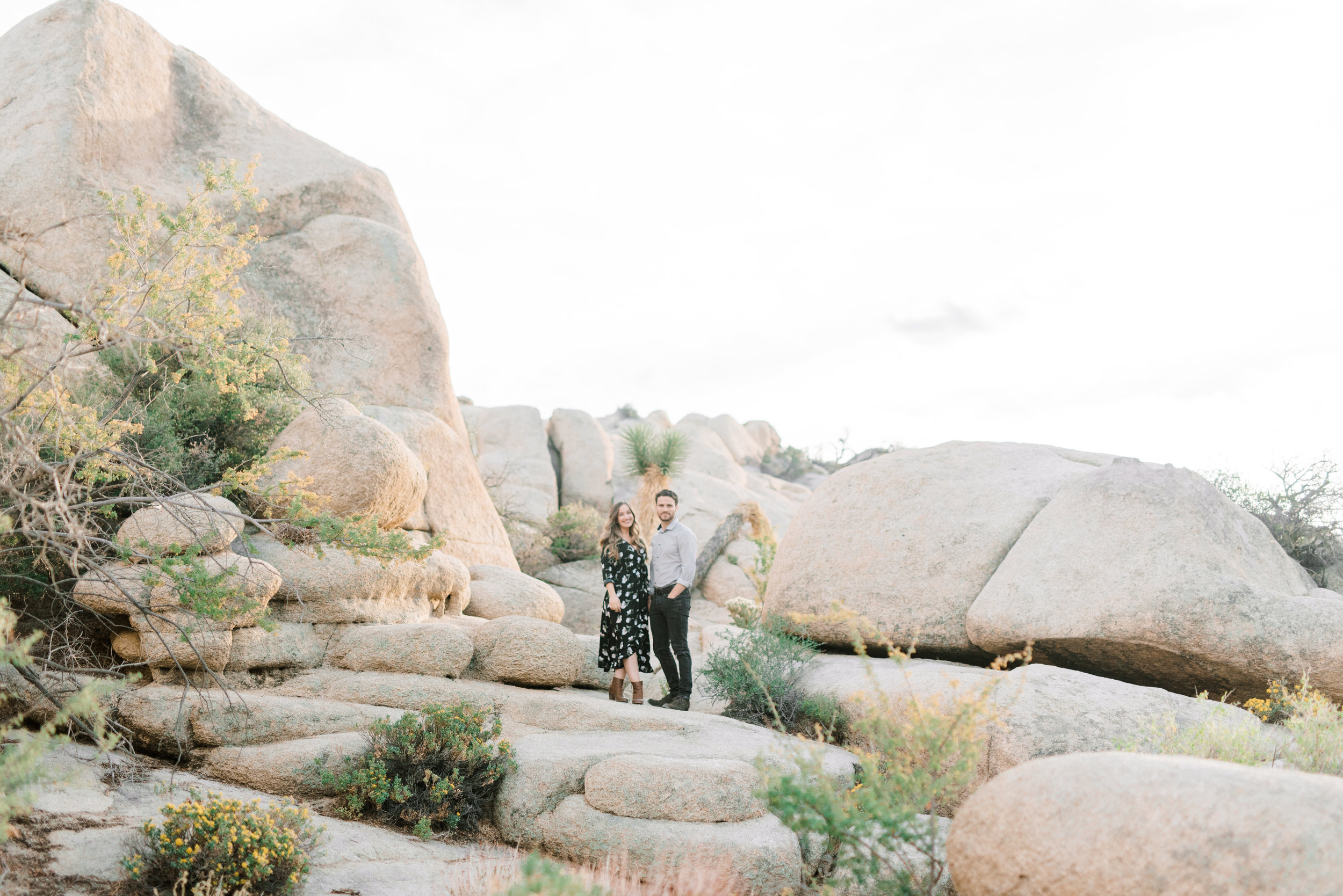 The rocky landscape in the sunset made for a dramatic backdrop at this free-spirited desert engagement session in Joshue Tree