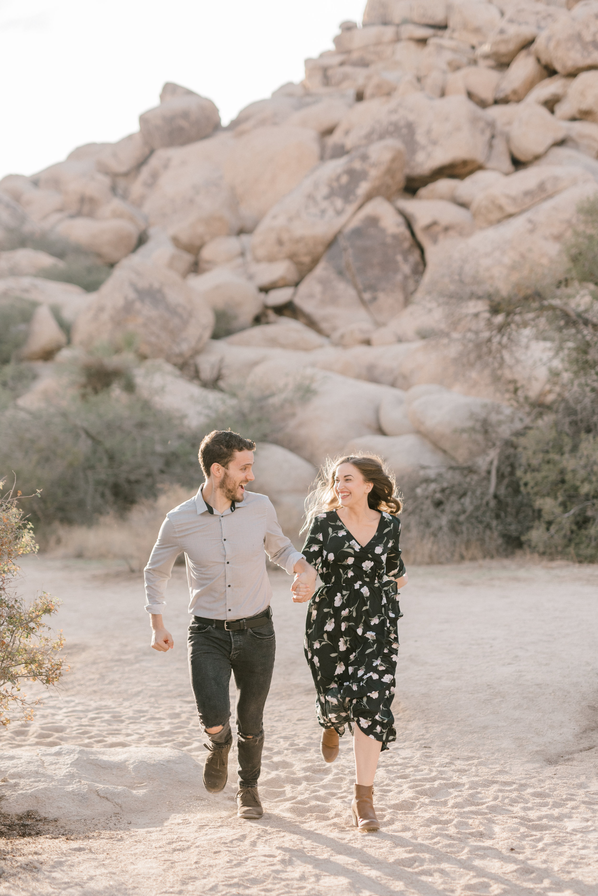 Running off into the sunset, this boho couple had so much frolicking through the desert for their free-spirited engagement session in Joshue Tree