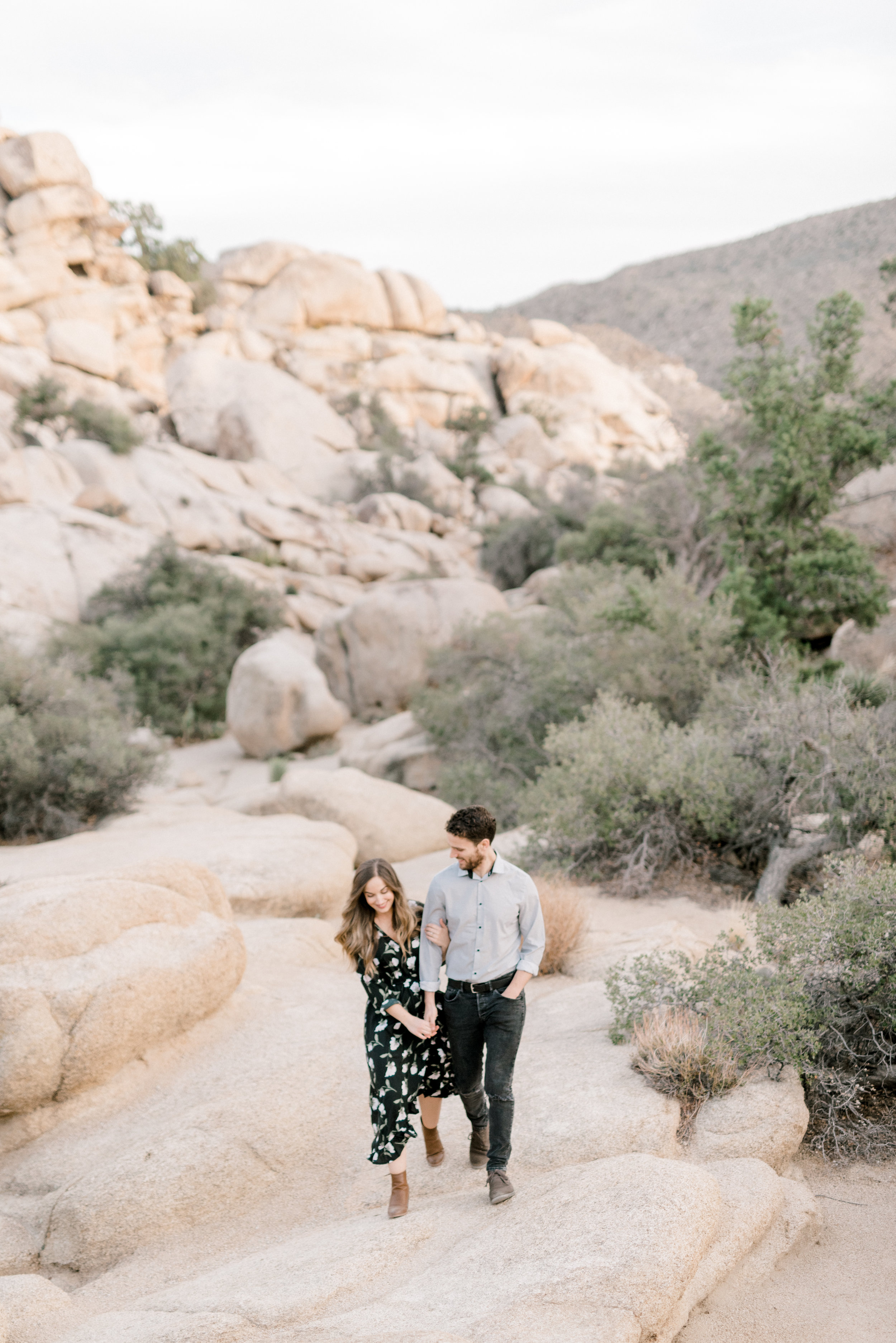 We love the rocky landscape from this free-spirited desert engagement session in Joshue Tree and these two walking hand in hand.