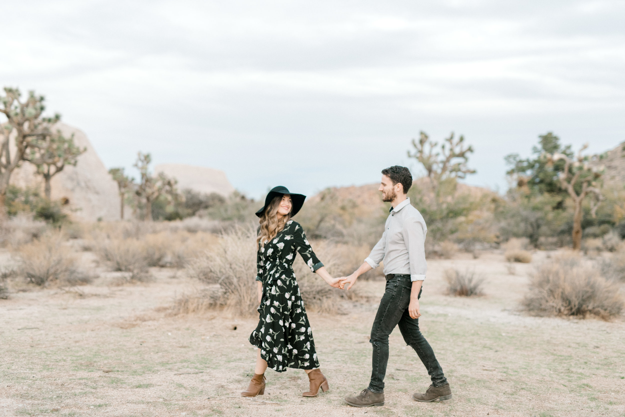 Follow me to forever, we are digging the boho vibes with this floral dress and floppy from Jenna and Sam's free-spirited desert engagement session in Joshue Tree