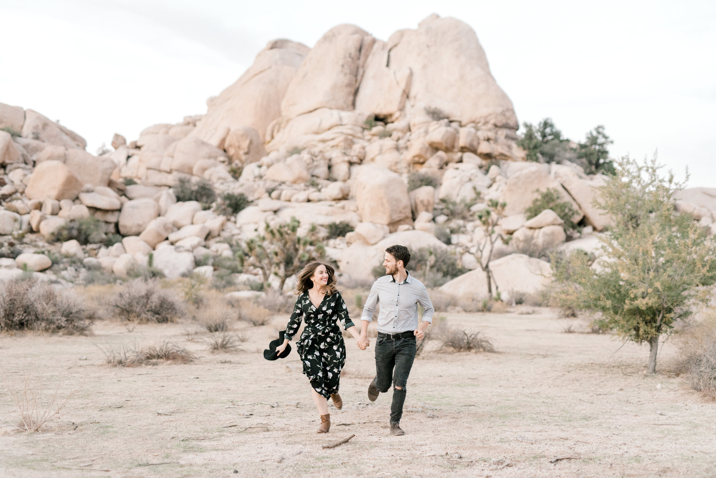 Nothing says fun like running through the desert with your love like Jenna and Sam for their free-spirited desert engagement session in Joshue Tree