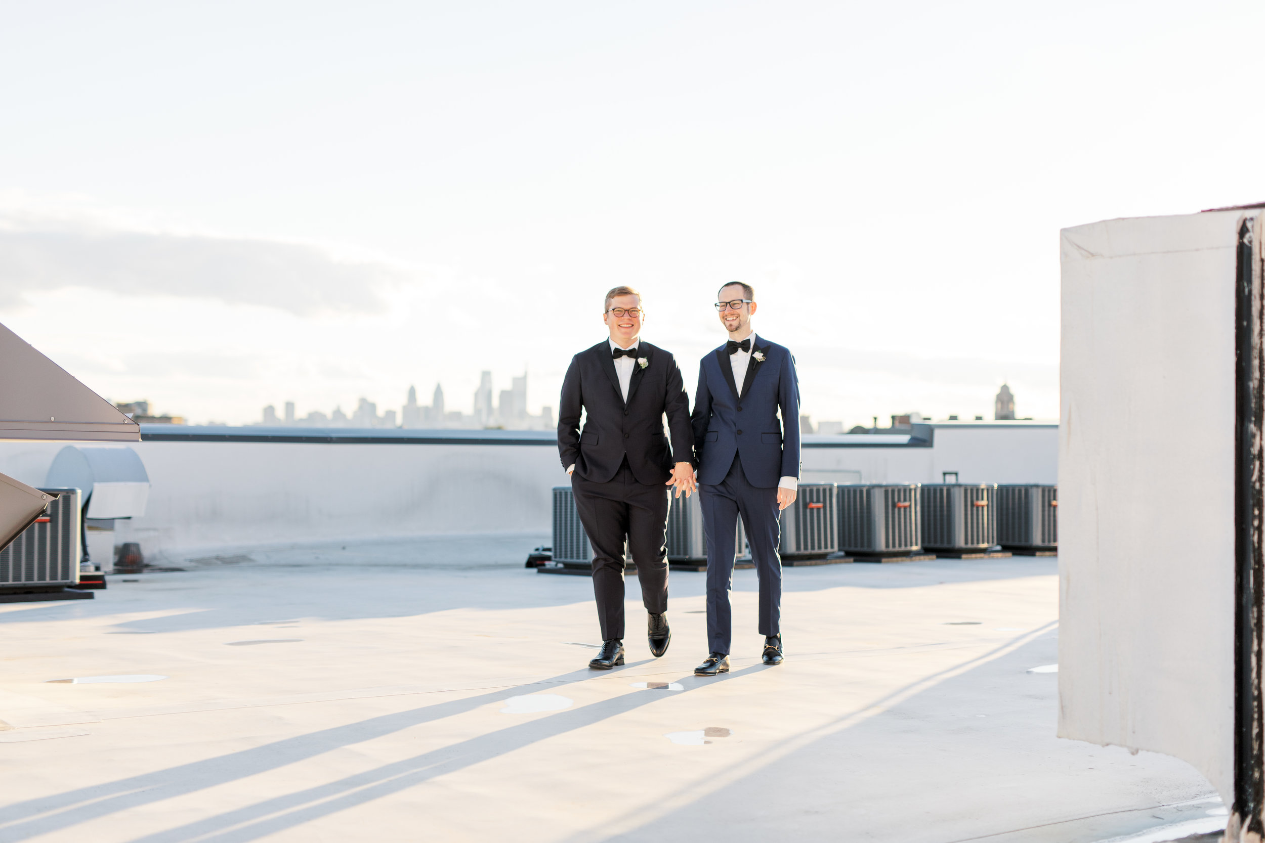 same sex roof-top industrial philadelphia wedding with skyline view at FAME by Haley Richter Photography