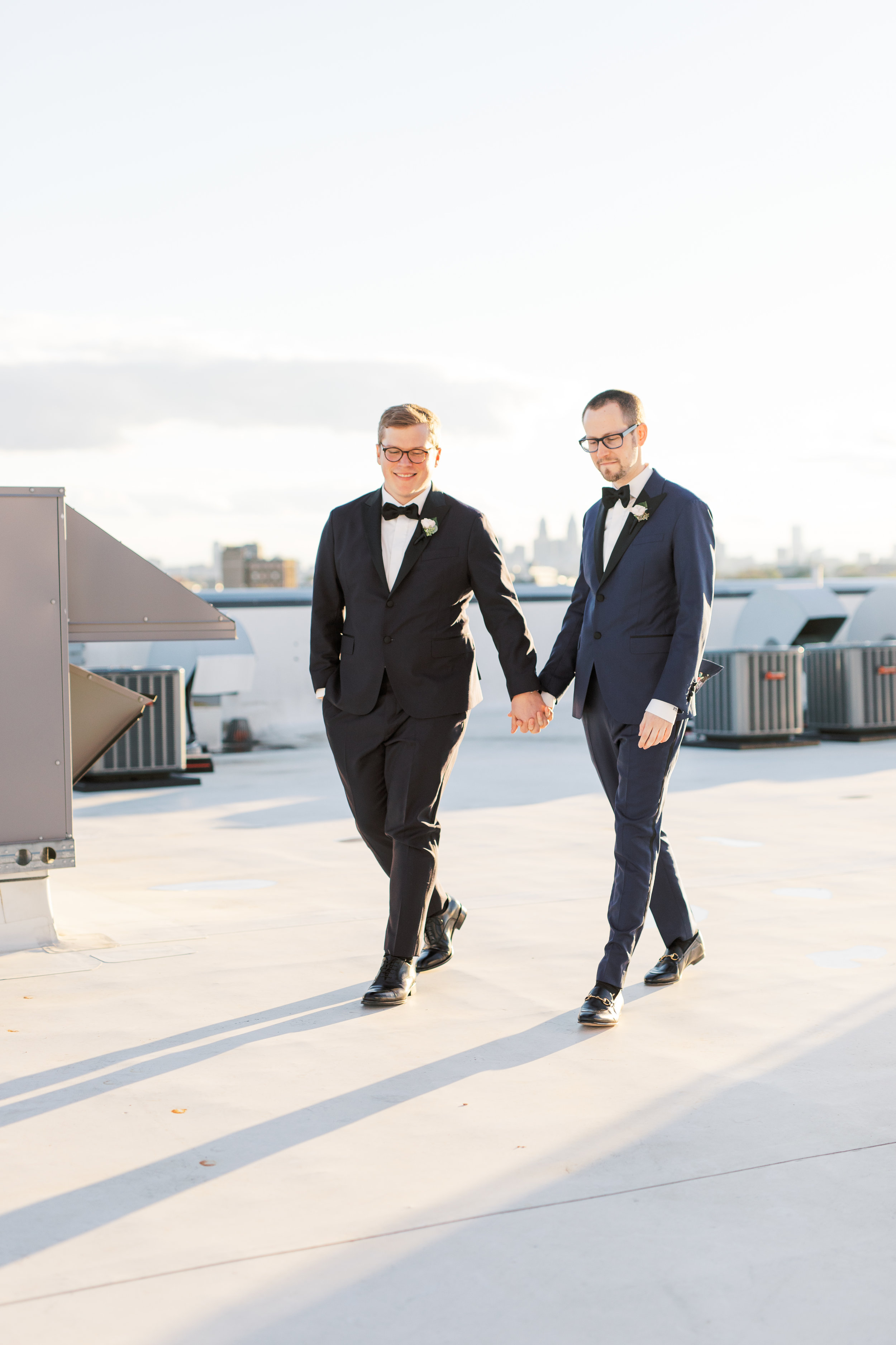 same sex wedding on a industrial and modern rooftop at FAME in Philadelphia with skyline view