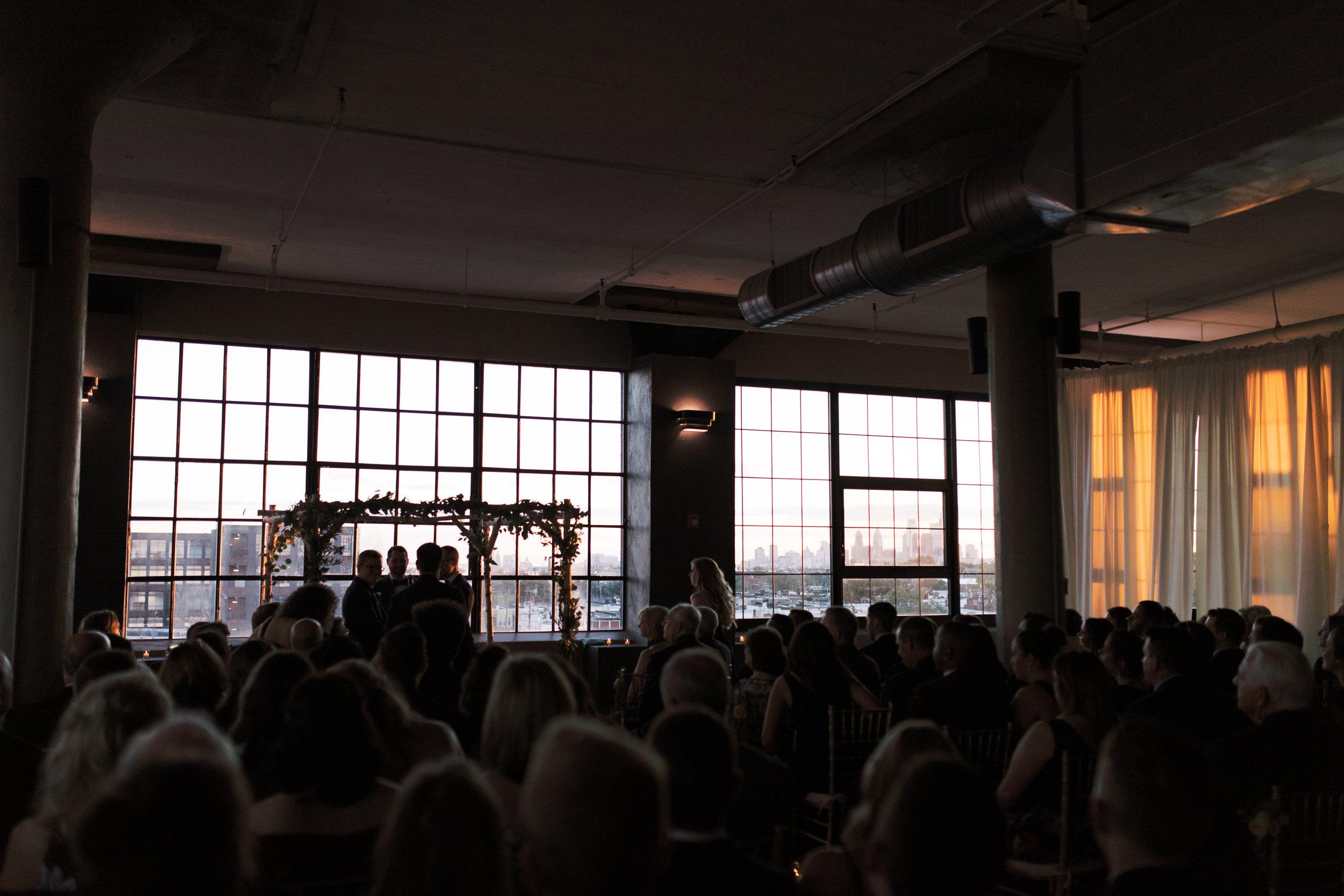 same sex wedding ceremony at FAME, industrial and modern warehouse Philadelphia wedding venue
