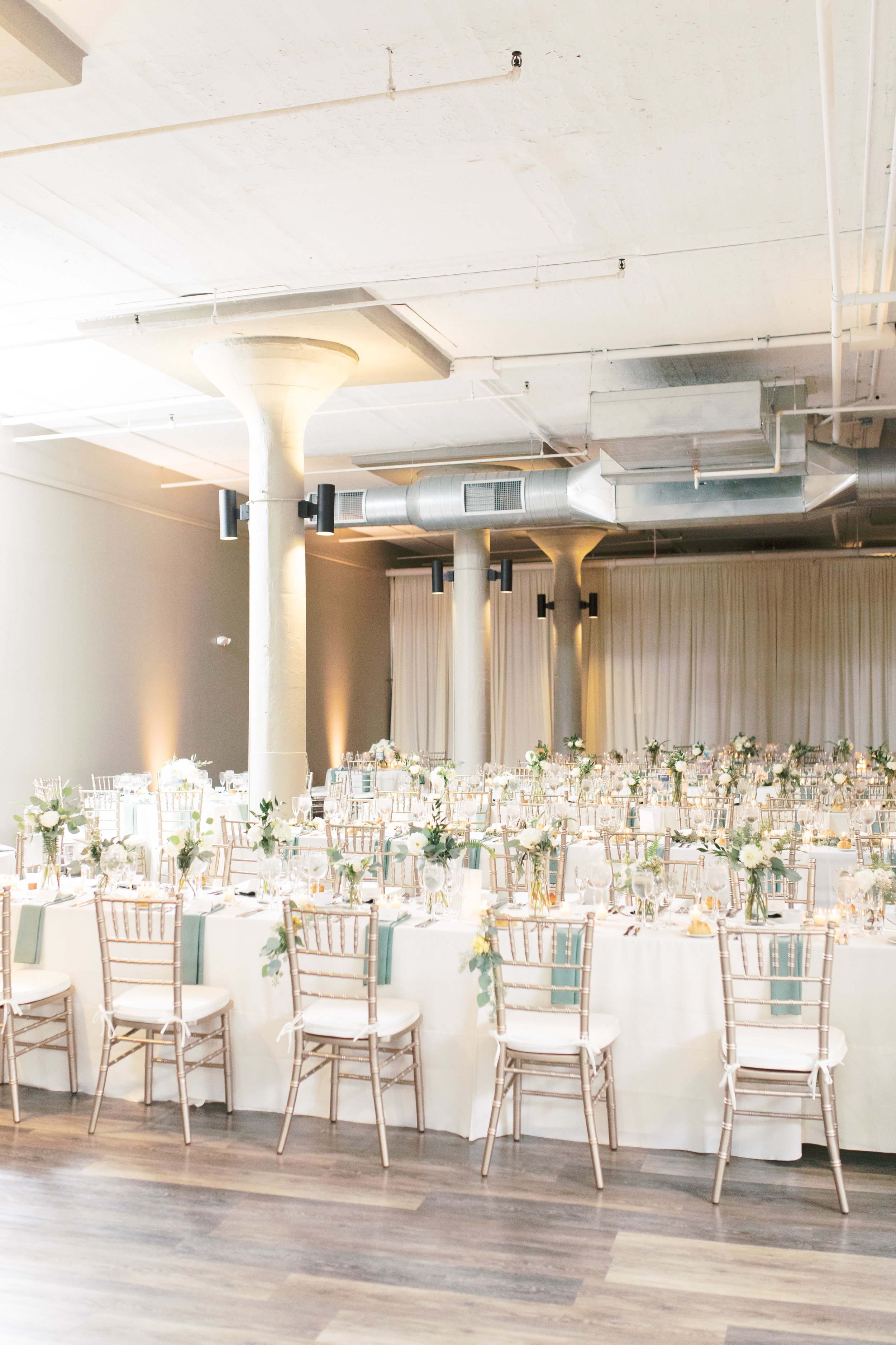 Reception setup at FAME, industrial and modern warehouse Philadelphia wedding venue by Haley Richter Photography
